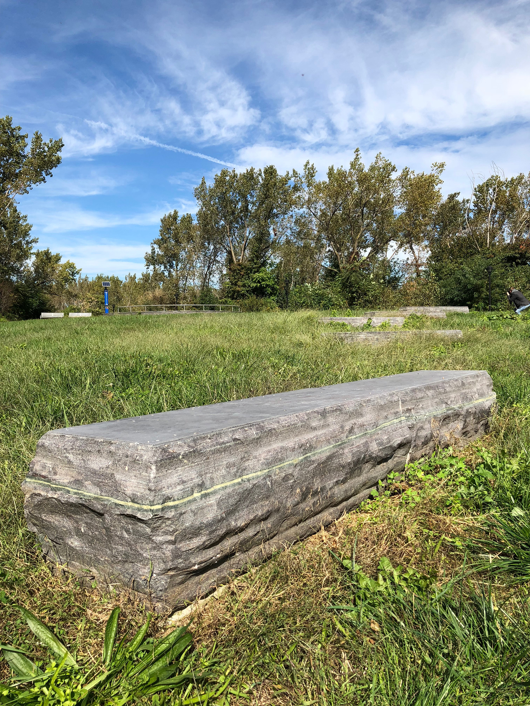Large stone in field in park
