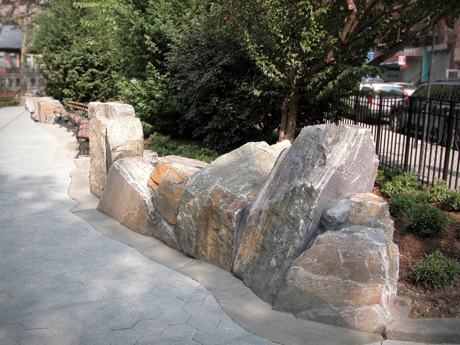 Landscaping stone next to walkway
