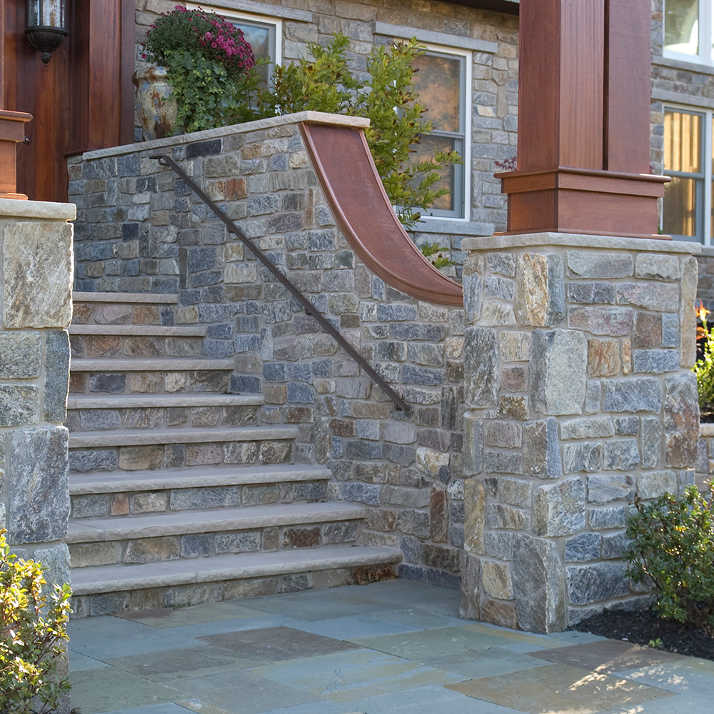 Stairs and porch constructed from champlain stone natural stone products