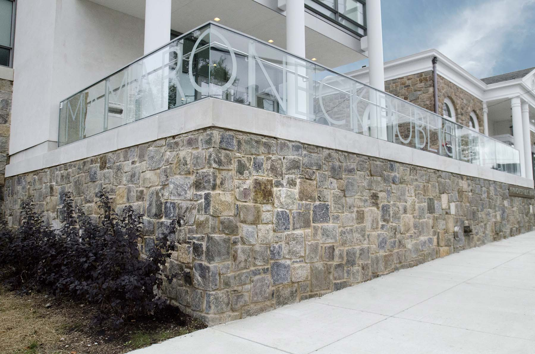 Natural stone retaining wall constructed from 1763 granite