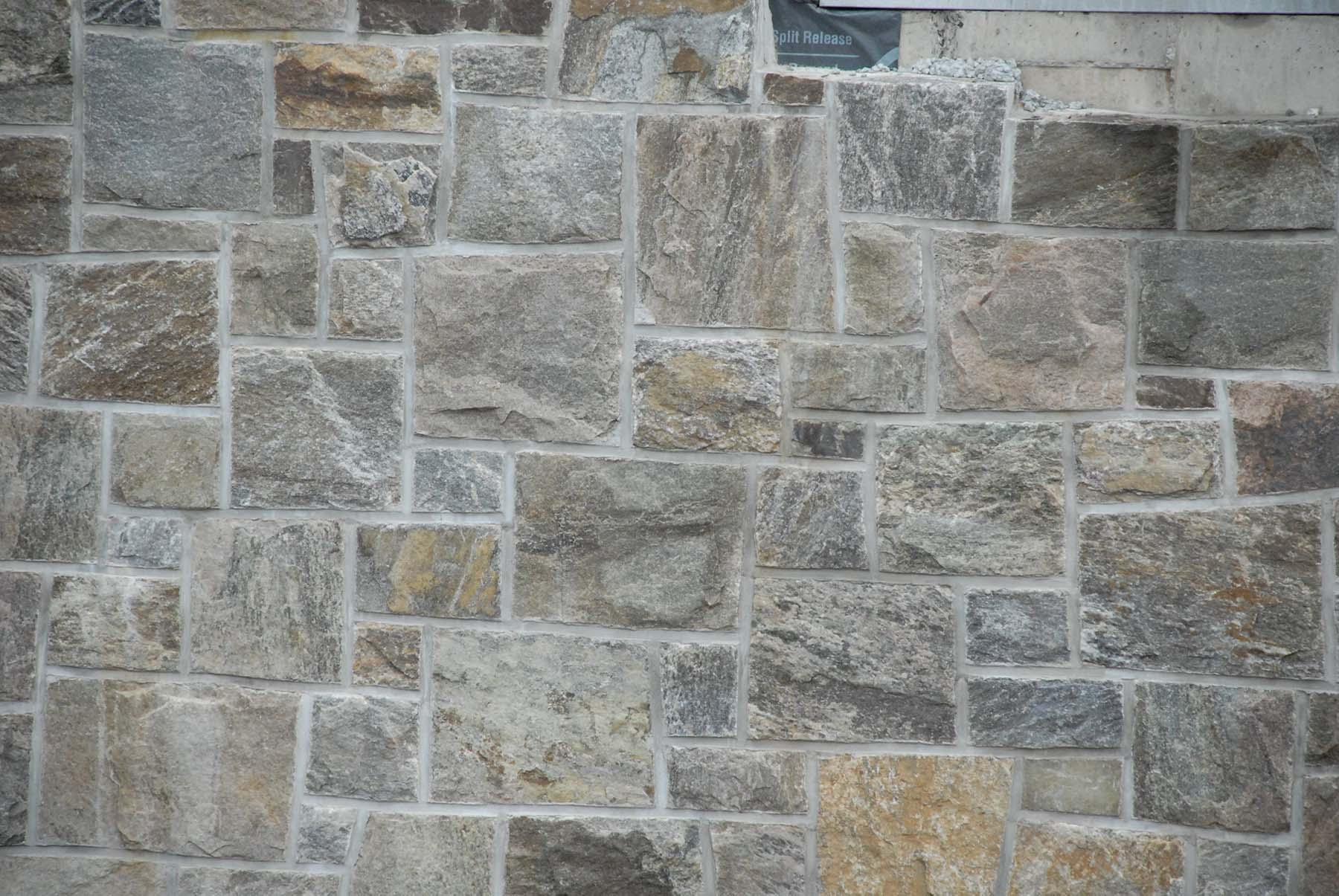 Close up of natural stone wall constructed from 1763 granite