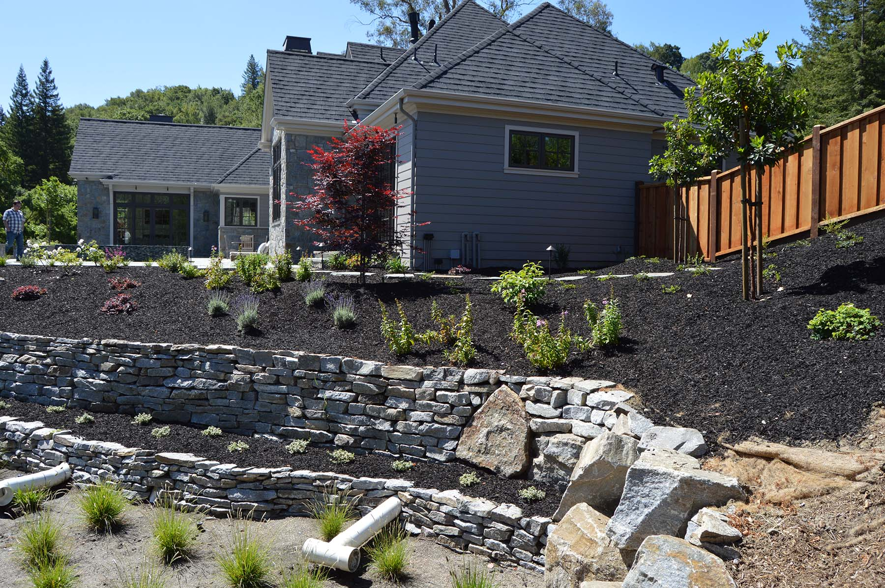 natural stone wall retaining wall at Toledo Court