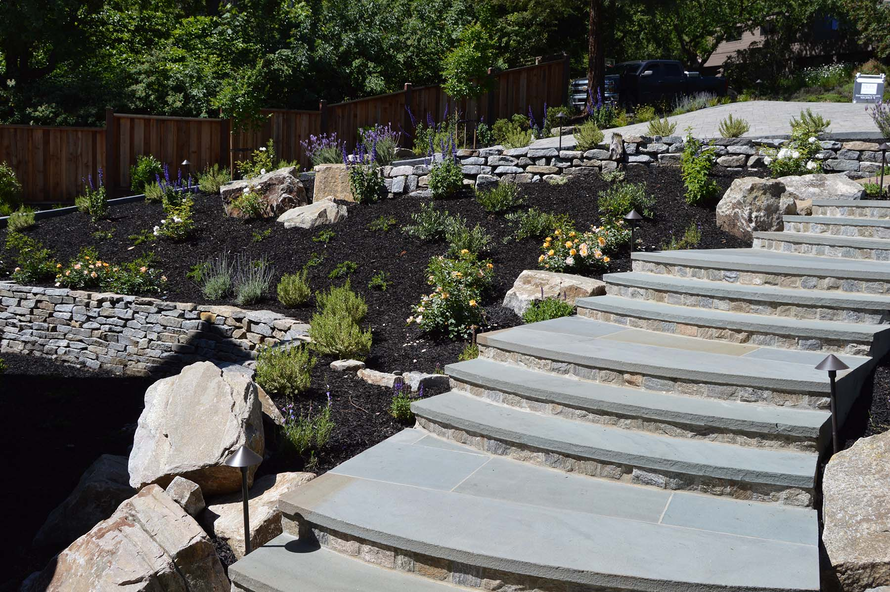 natural stone stairs and retaining walls at toledo court property