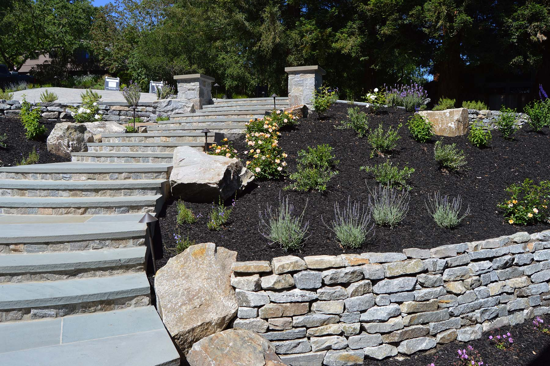natural stone stairs and retaining wall at toledo court property