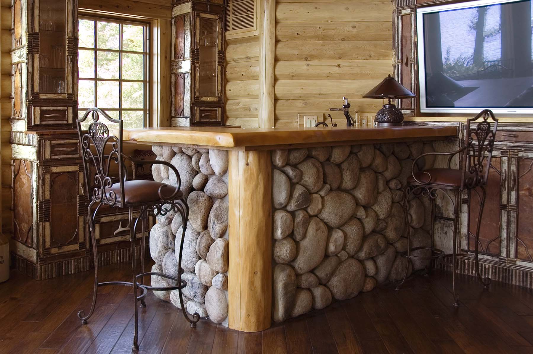 Adirondack Fieldstone bar in log cabin