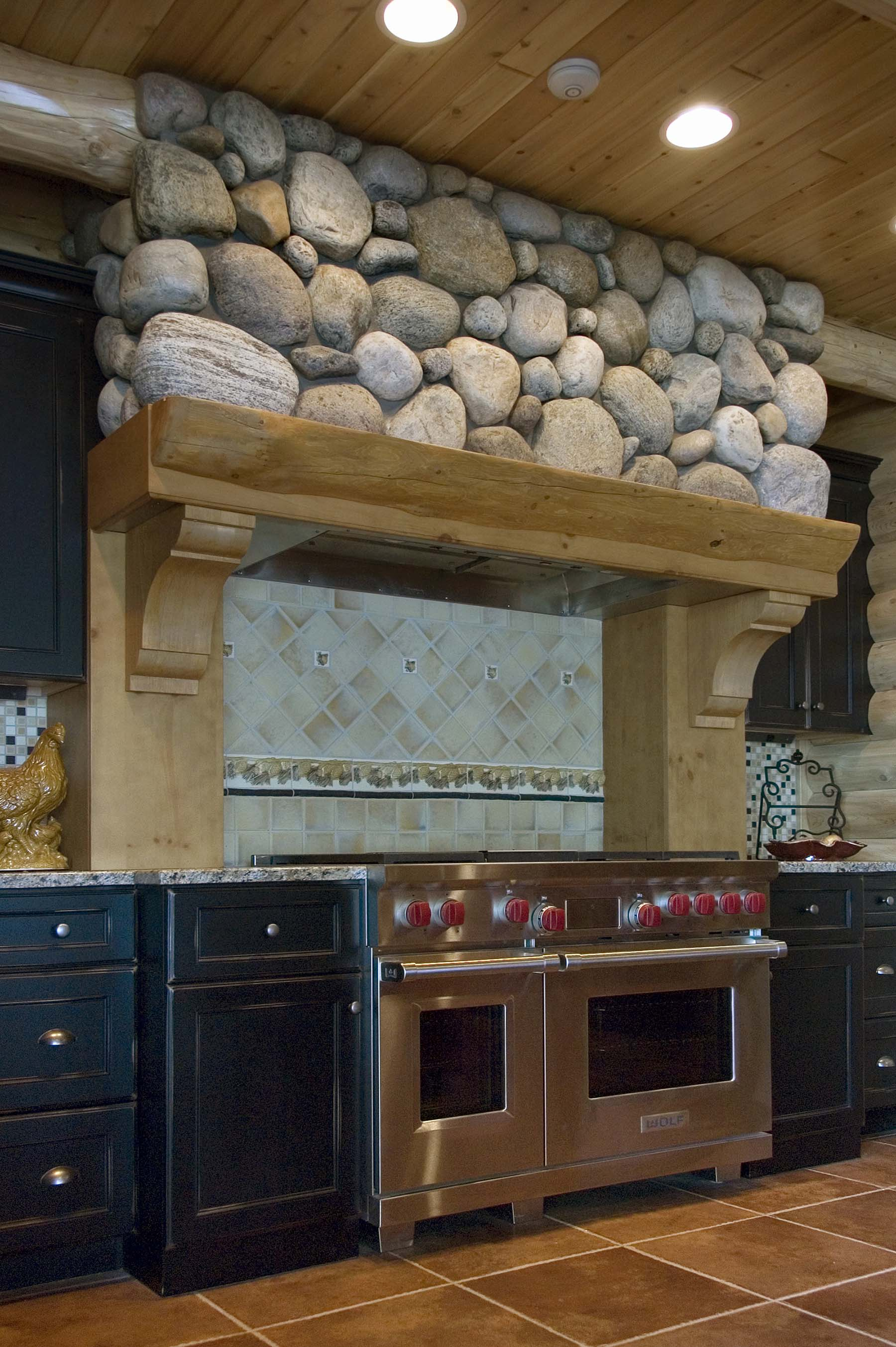 Adirondack Fieldstone wall above stovetop in kitchen