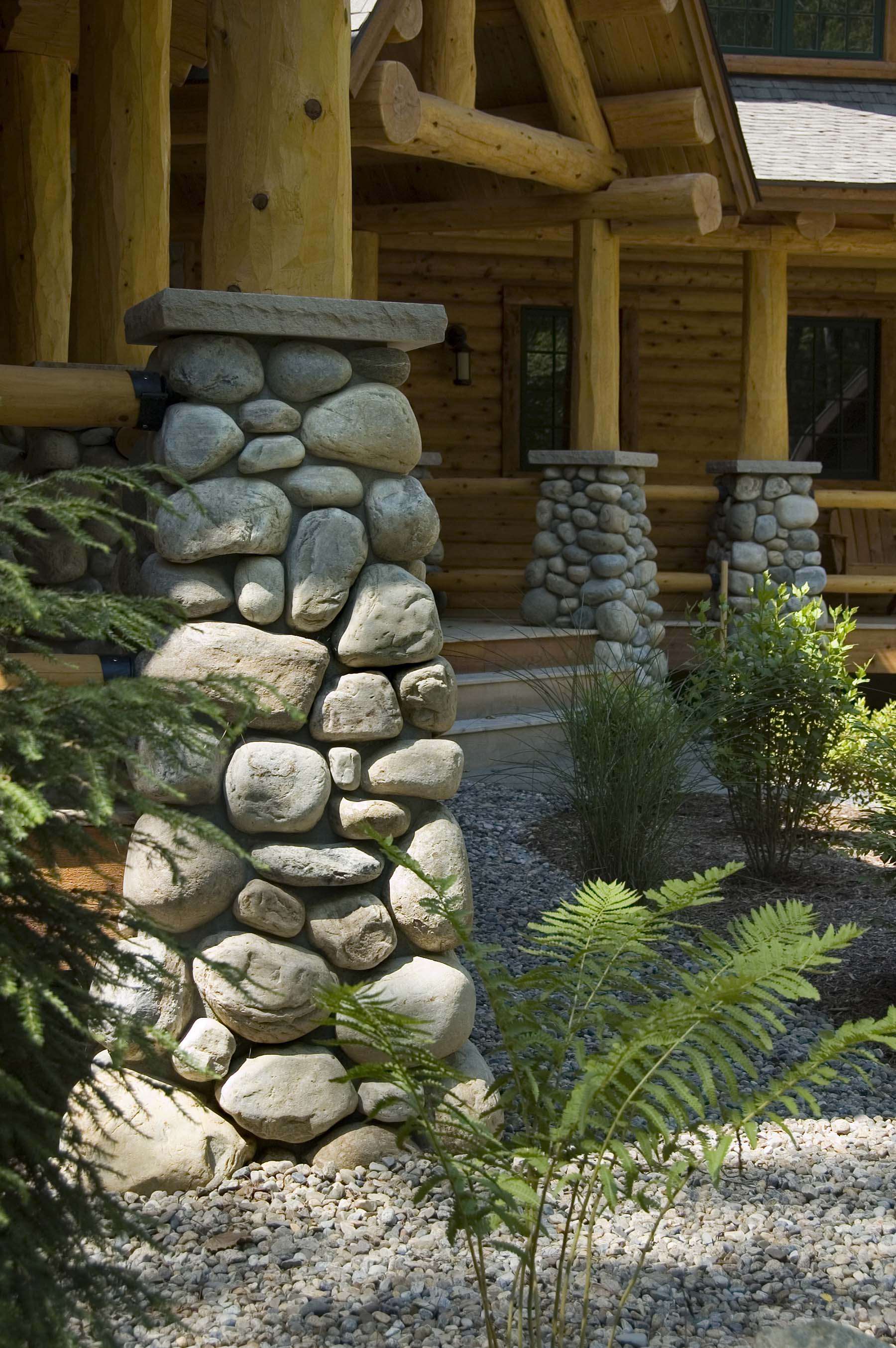 Adirondack Fieldstone Columns on log cabin