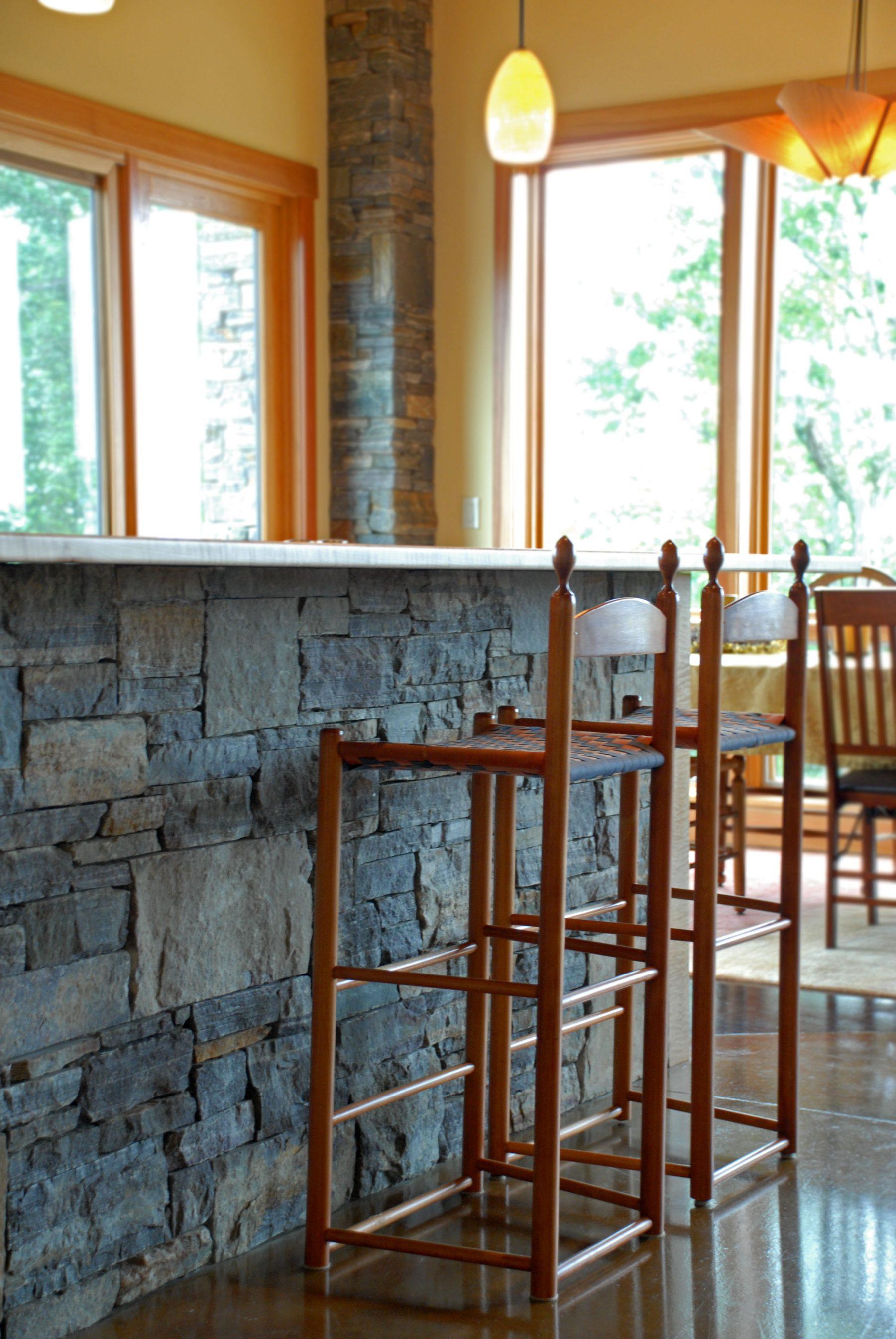chairs at stone bar
