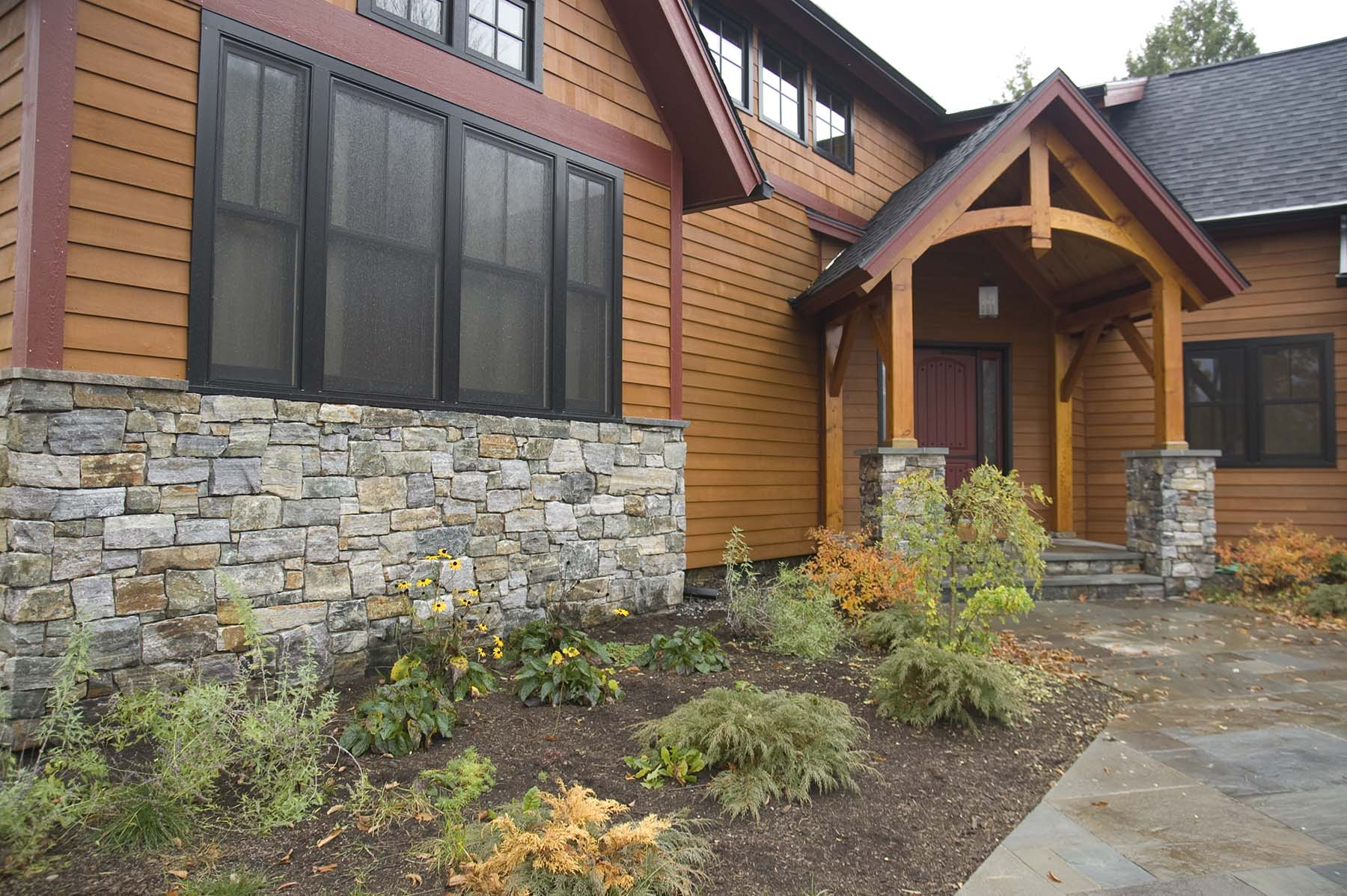 residential home with american granite natural stone exterior wall and porch