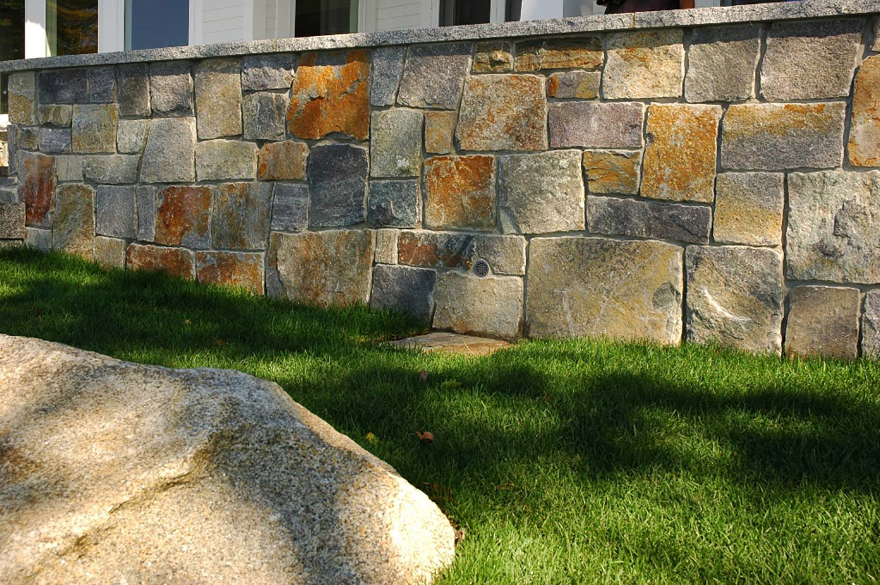 residential home with american granite natural stone exterior retaining wall