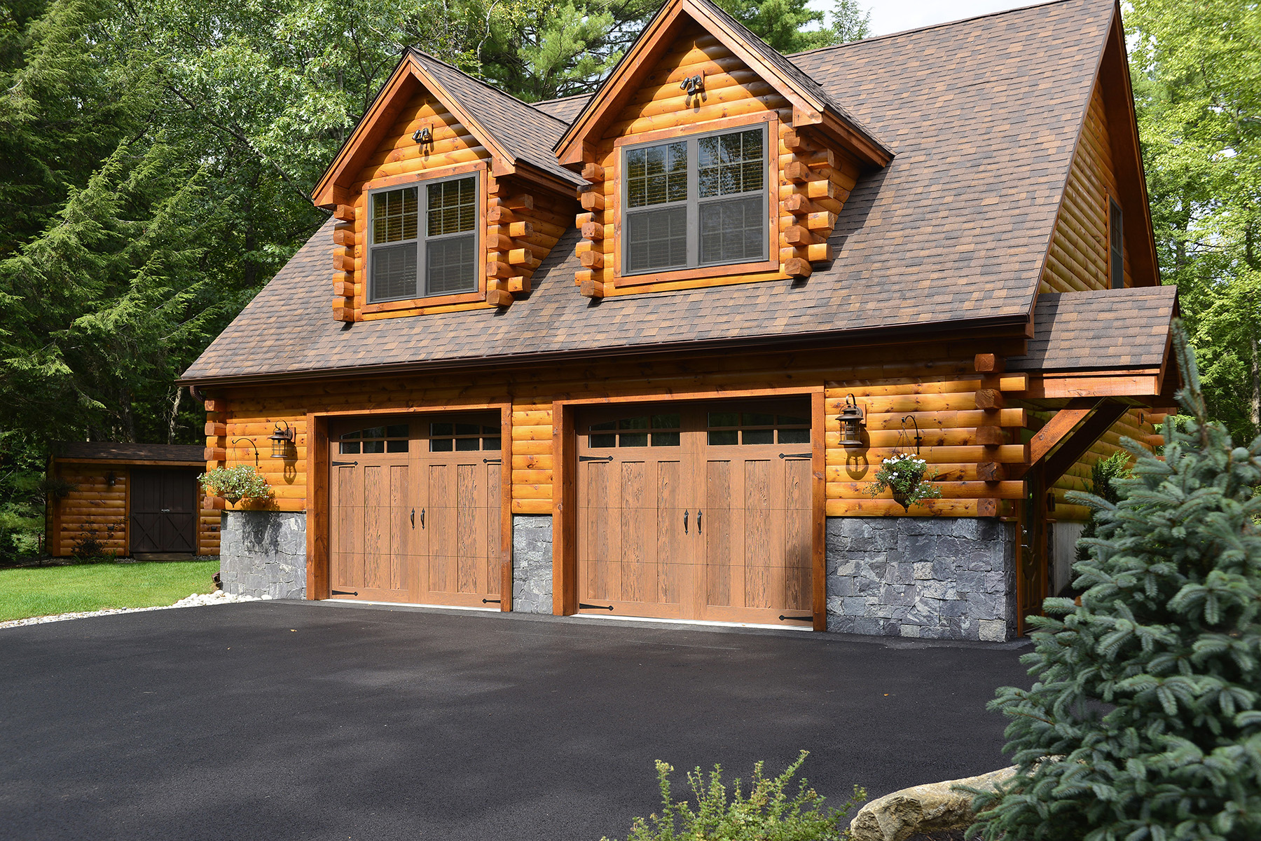 log garage house and driveway