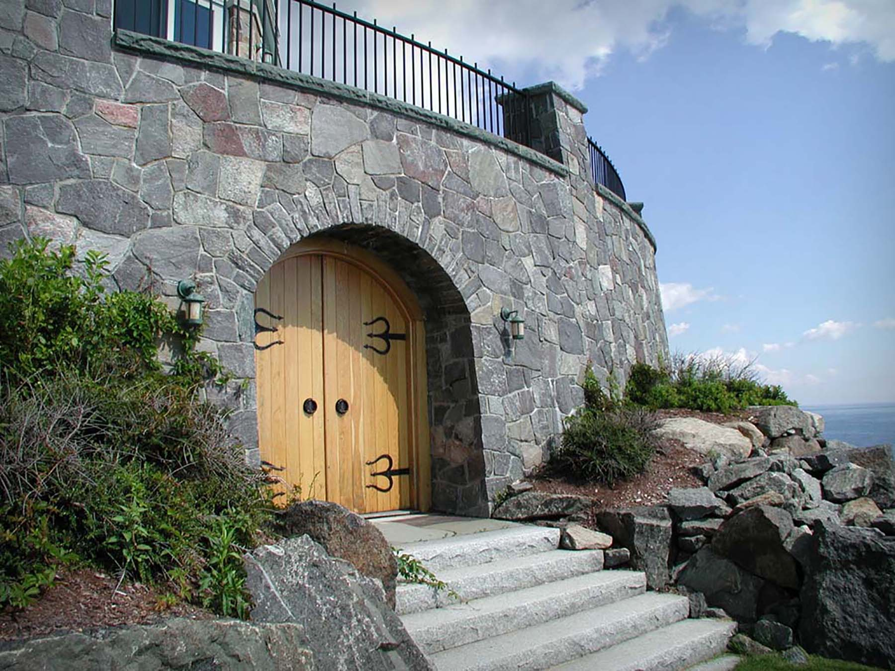 residential home with corinthian granite natural stone exterior