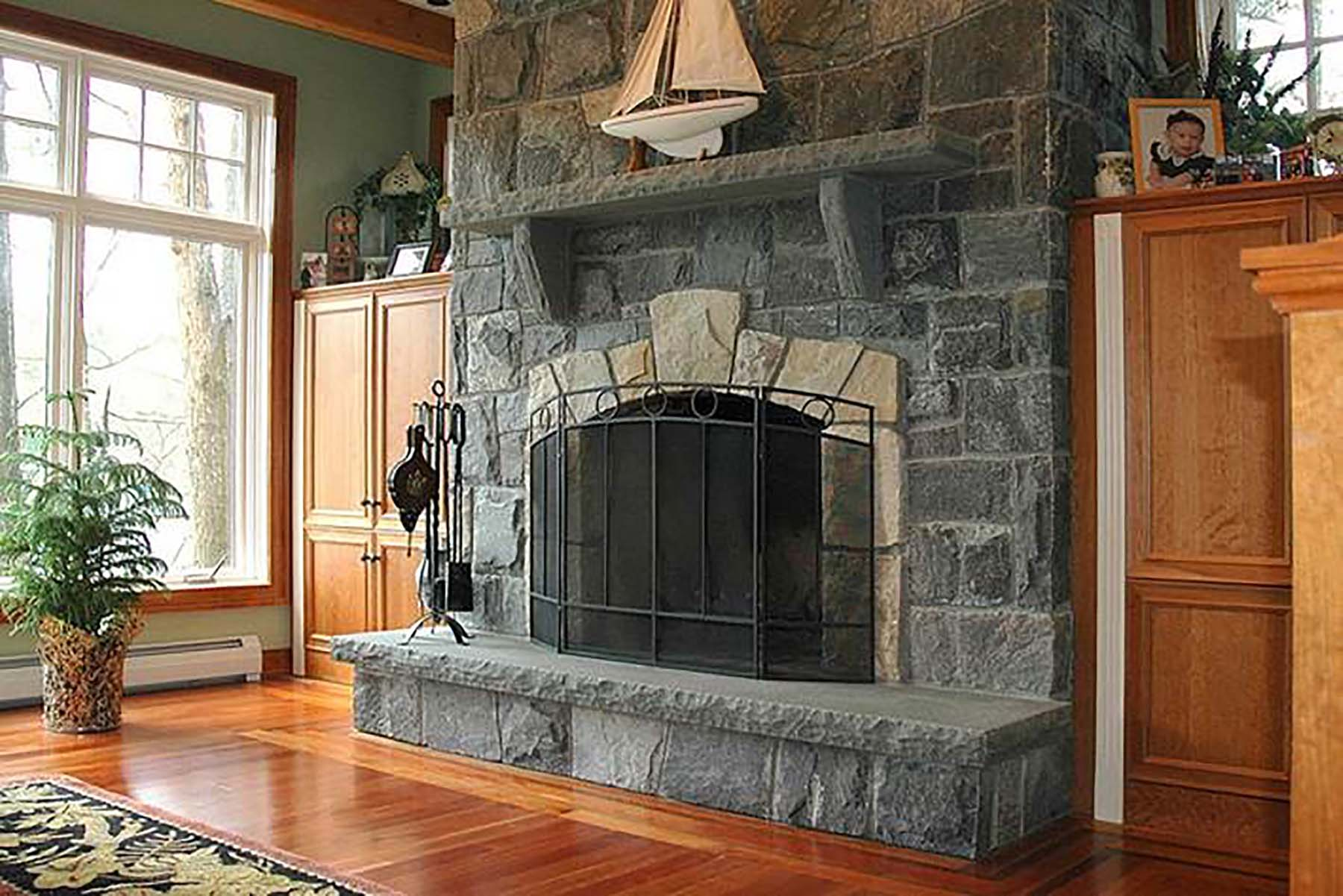 residential home with corinthian granite natural stone fireplace
