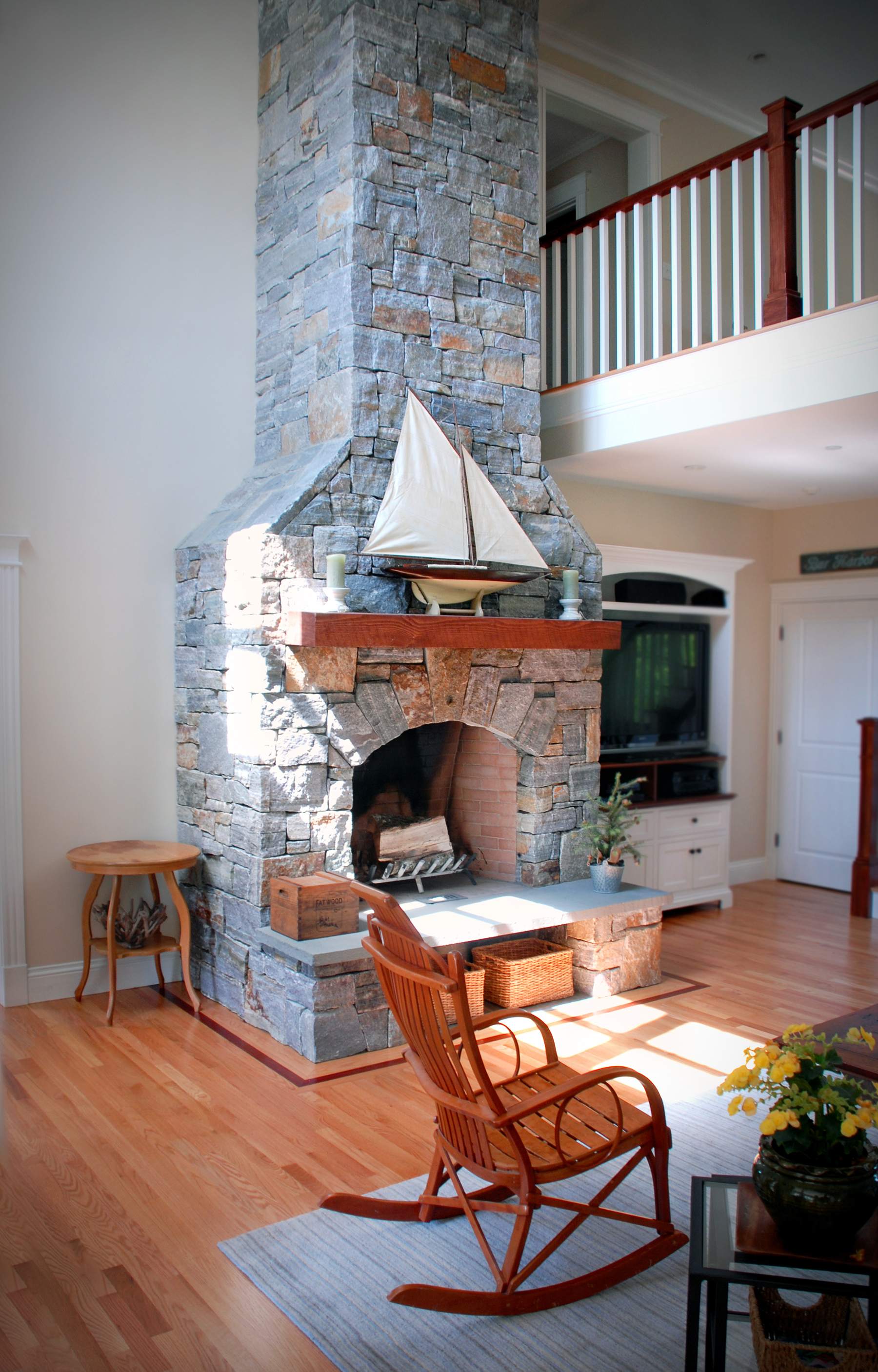 stone fireplace with model sailboat