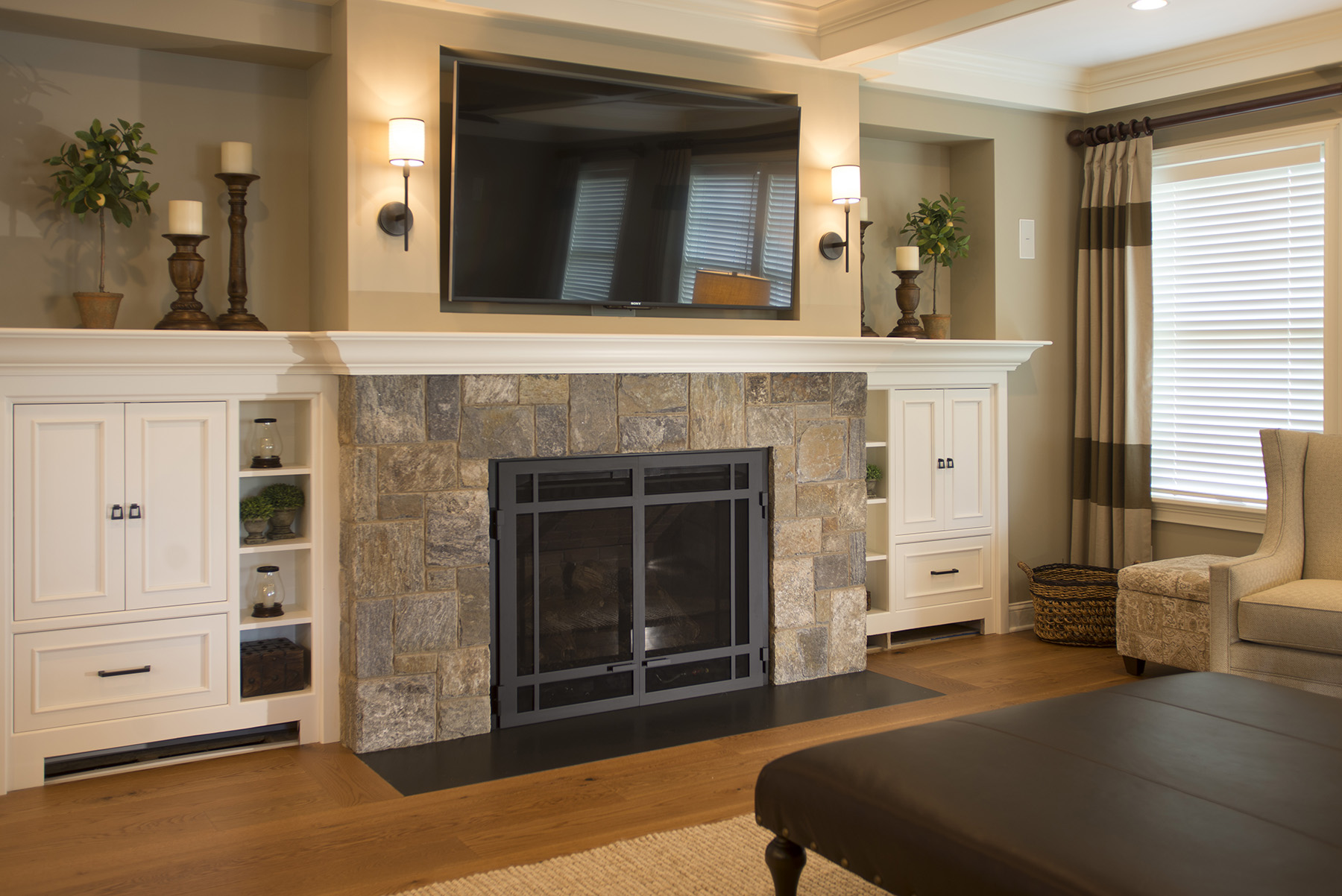 stone fireplace, tv above