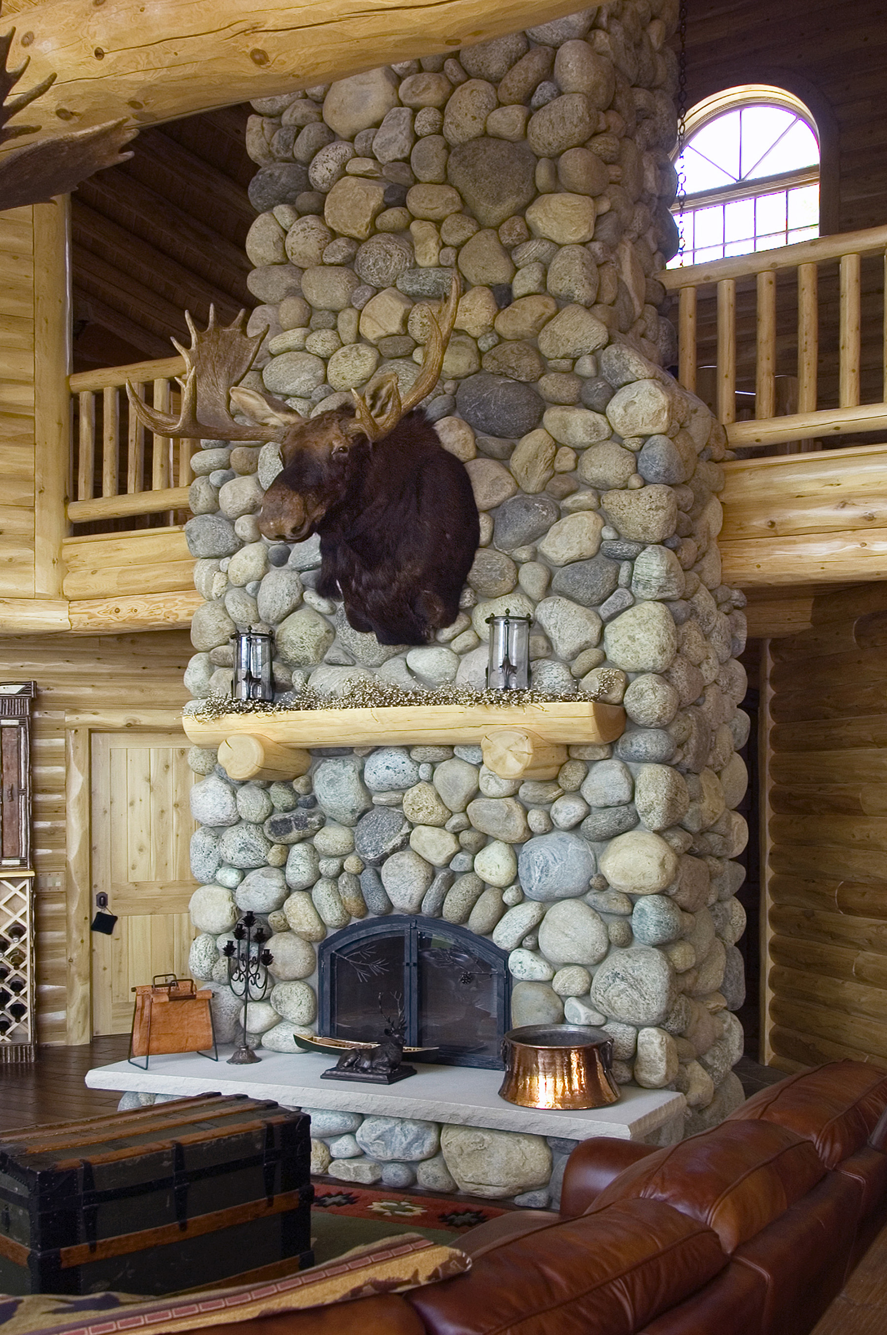 large fireplace with mounted moose head