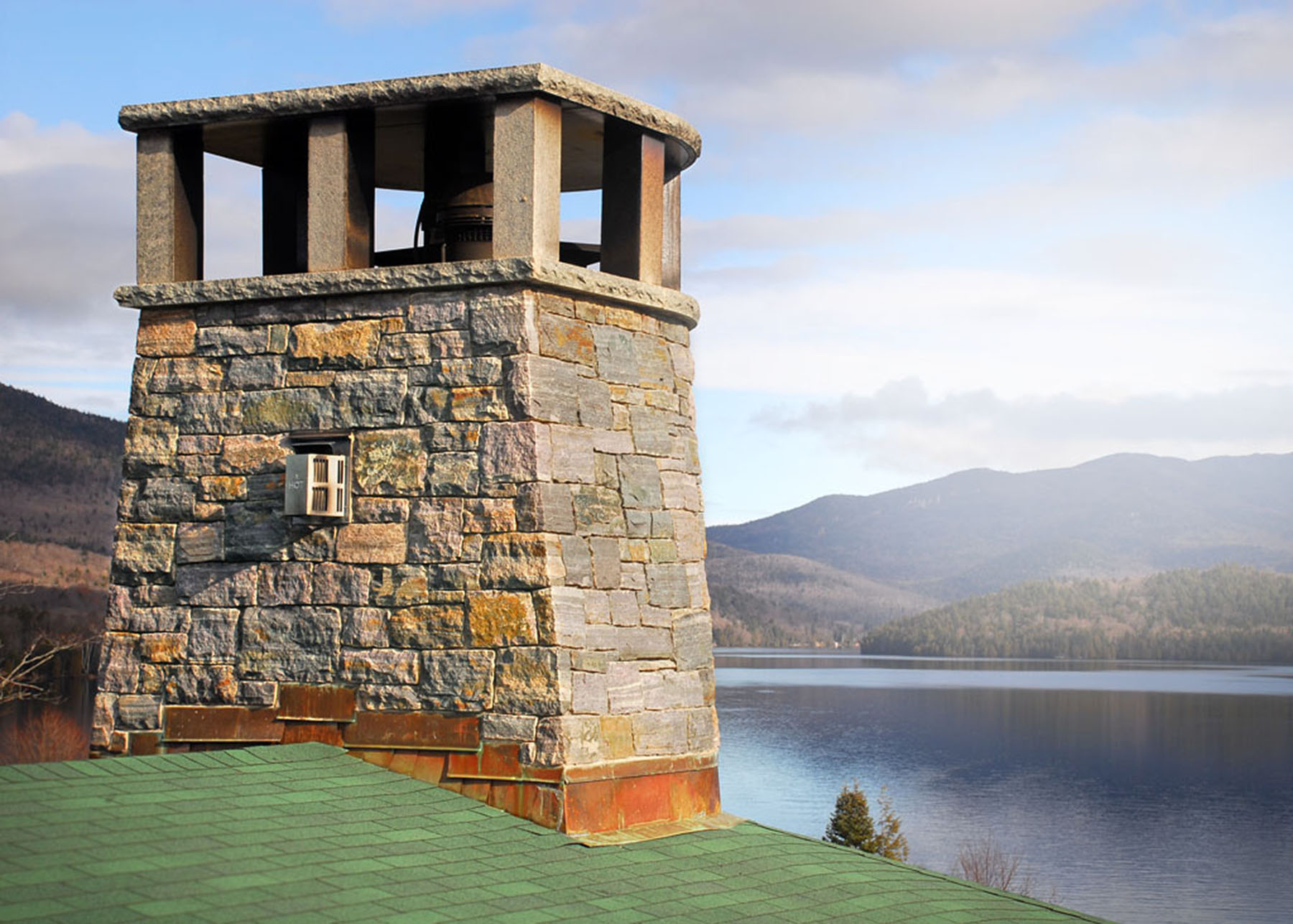 stone chimney overlooking lake
