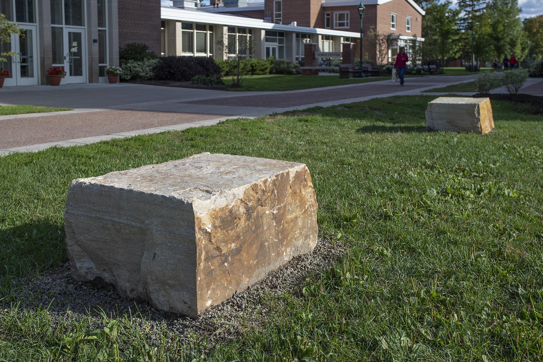 big stone in grass
