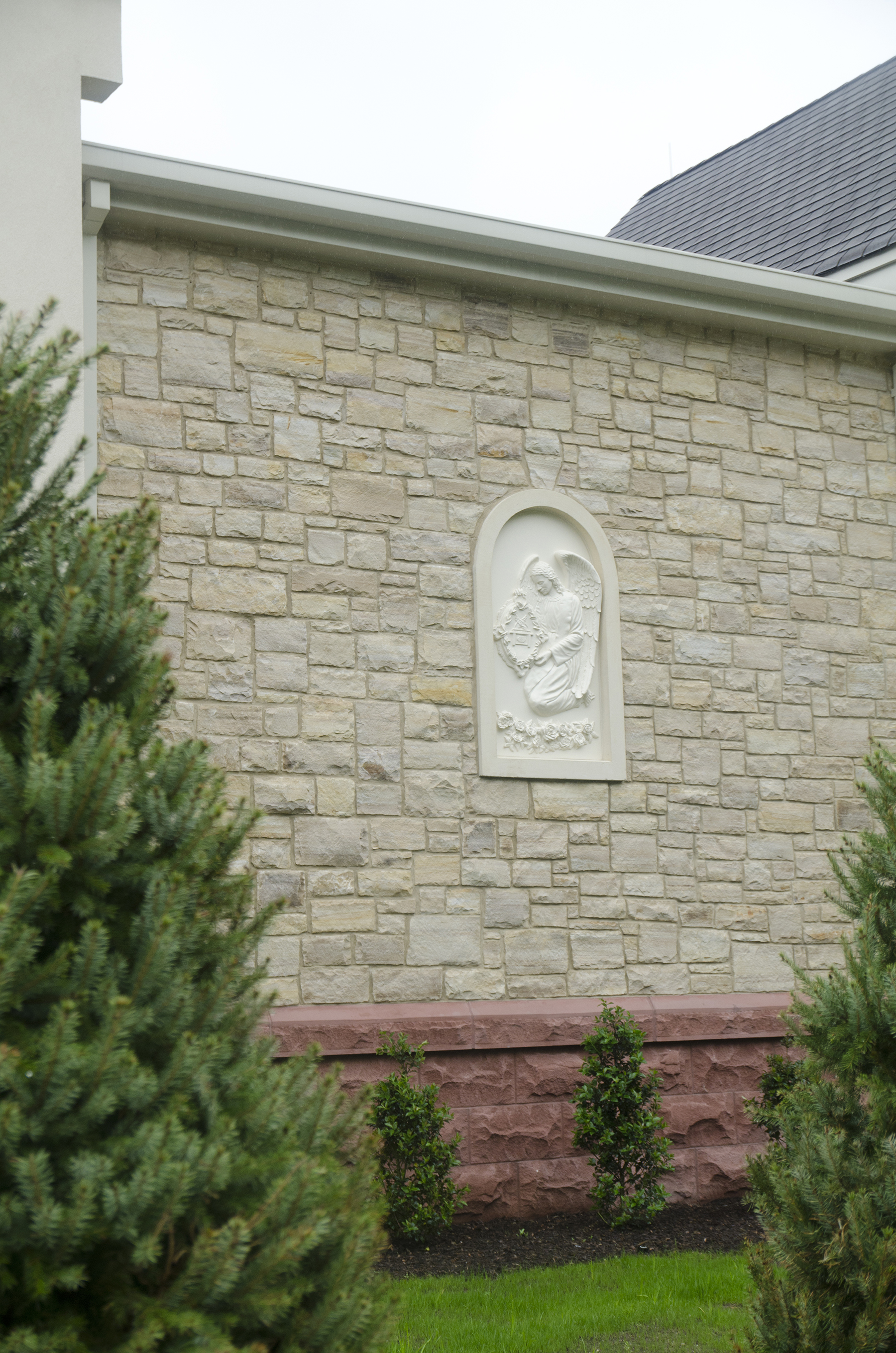 stone art on the side of wall