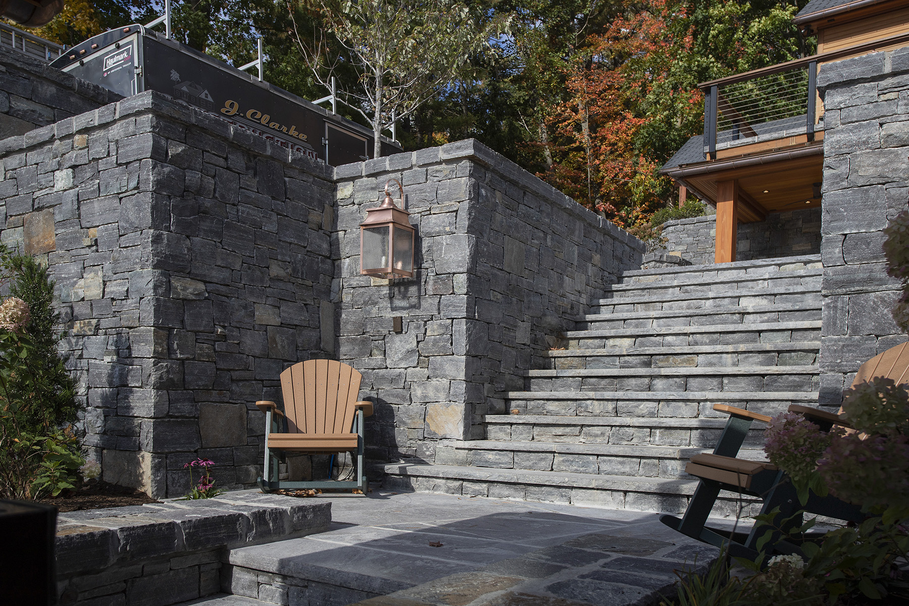 stone staircase with adirondack chairs