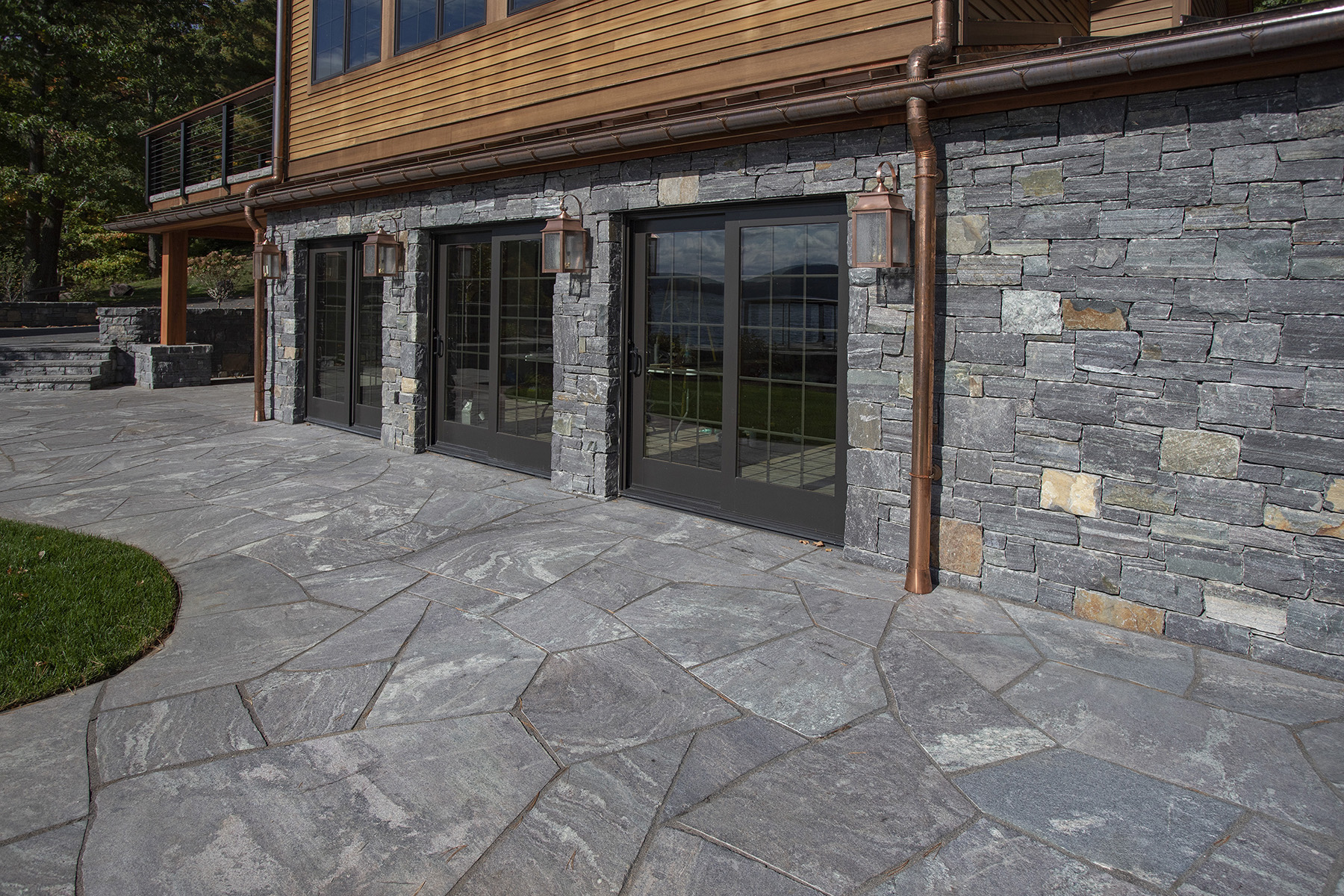 large stone sidewalk looking at building