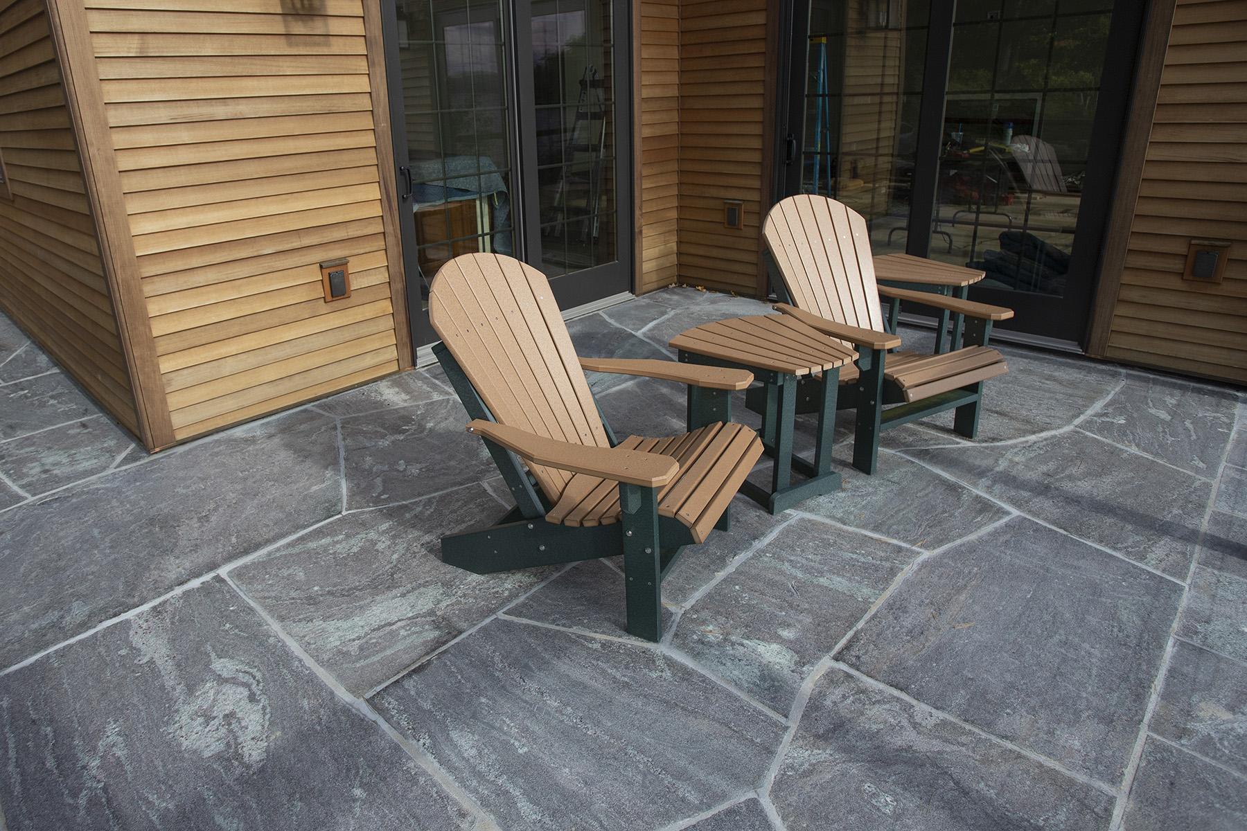 adirondack chairs atop stone sidewalk