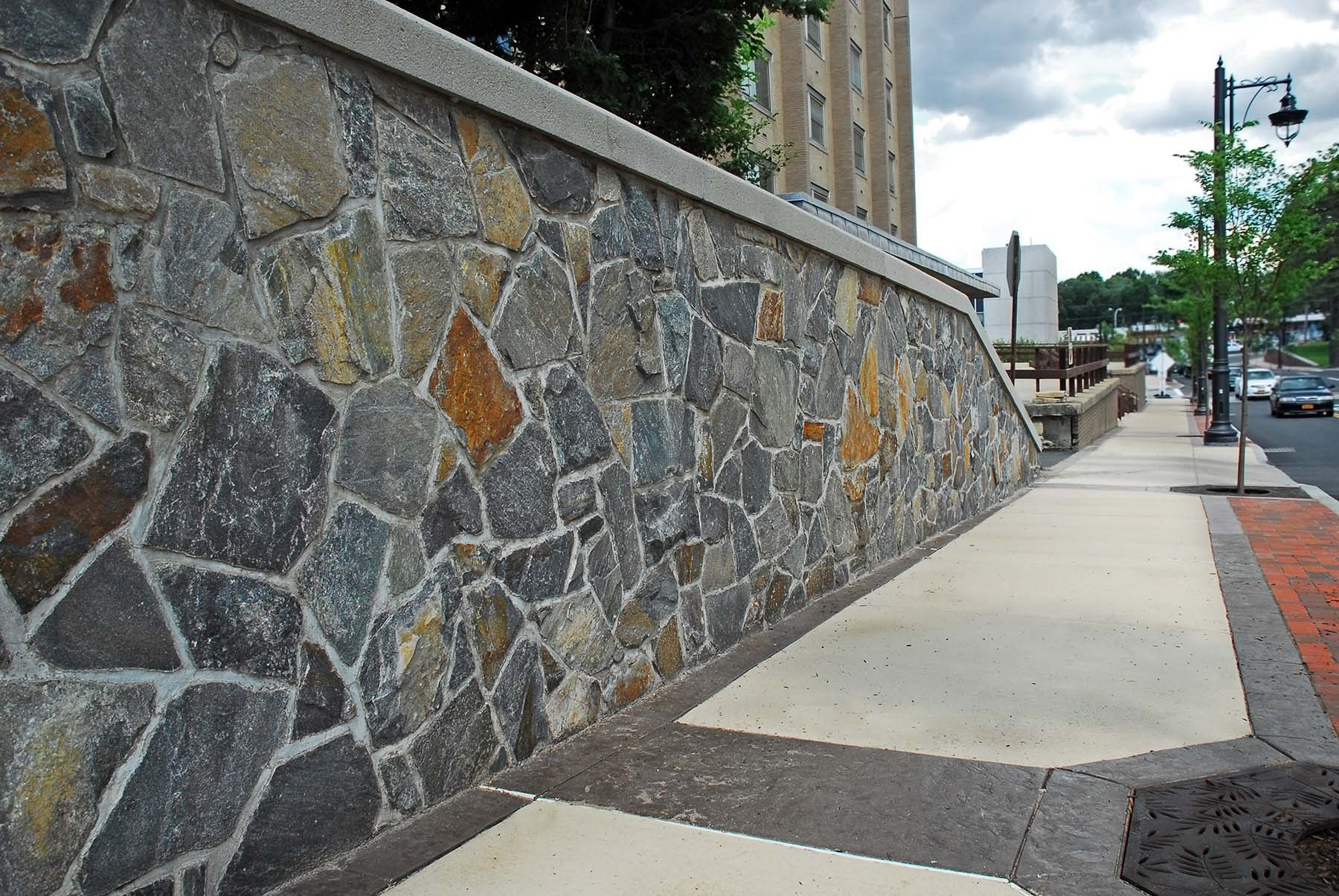 saratoga granite mosaic natural stone wall outside commercial building