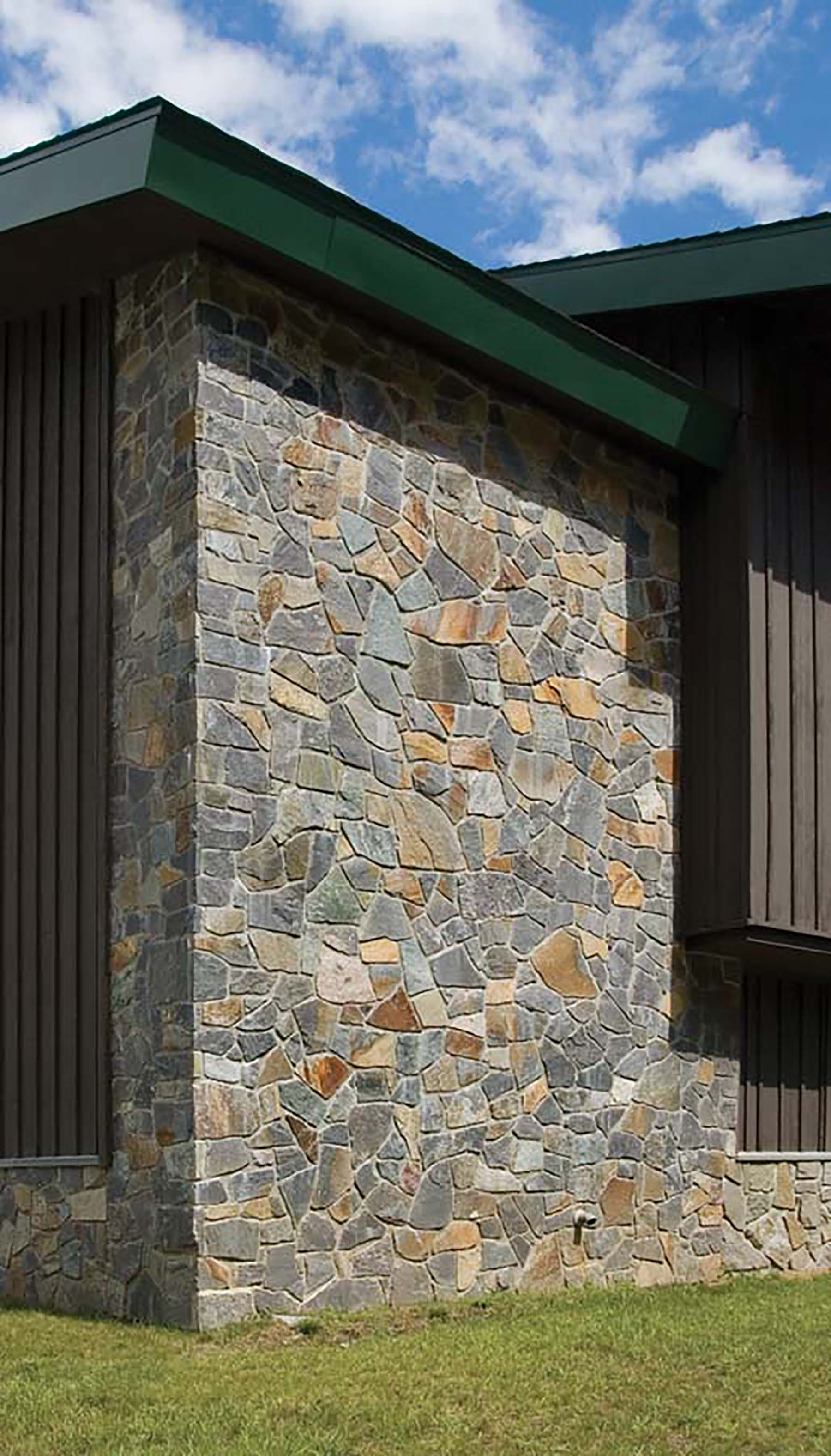 saratoga granite mosaic natural stone wall on residential building