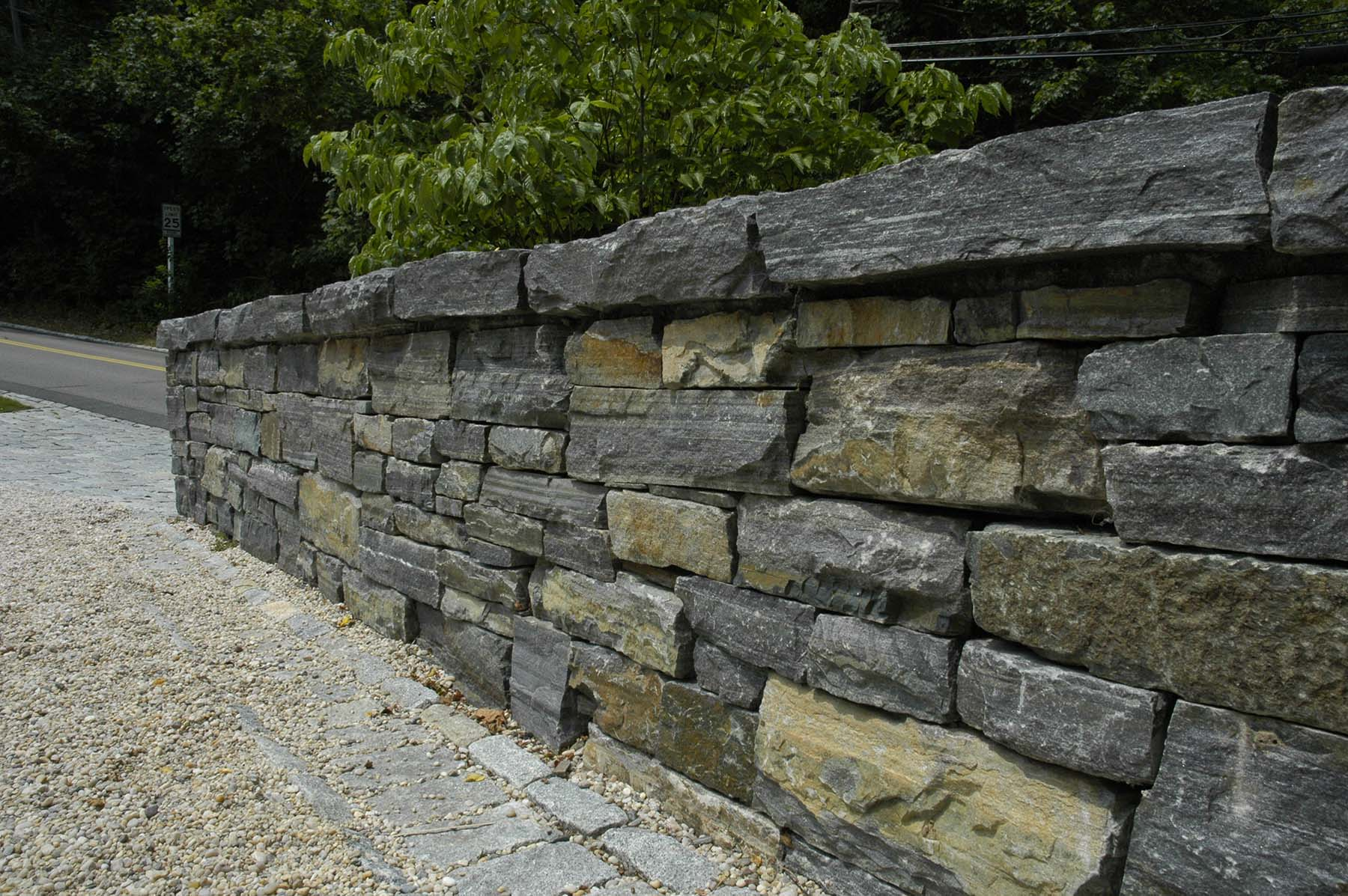 natural Adirondack stone wall by road