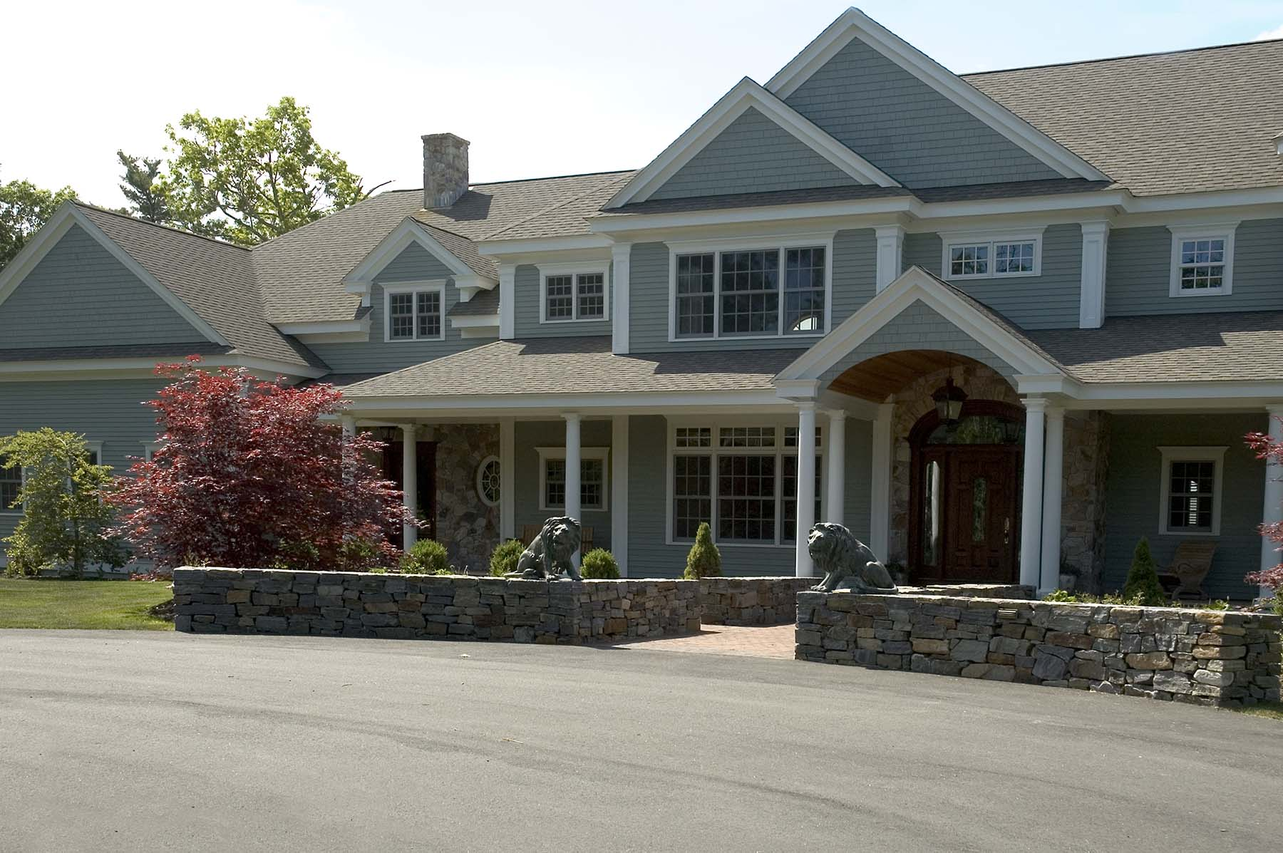 natural Adirondack stone wall in front of house