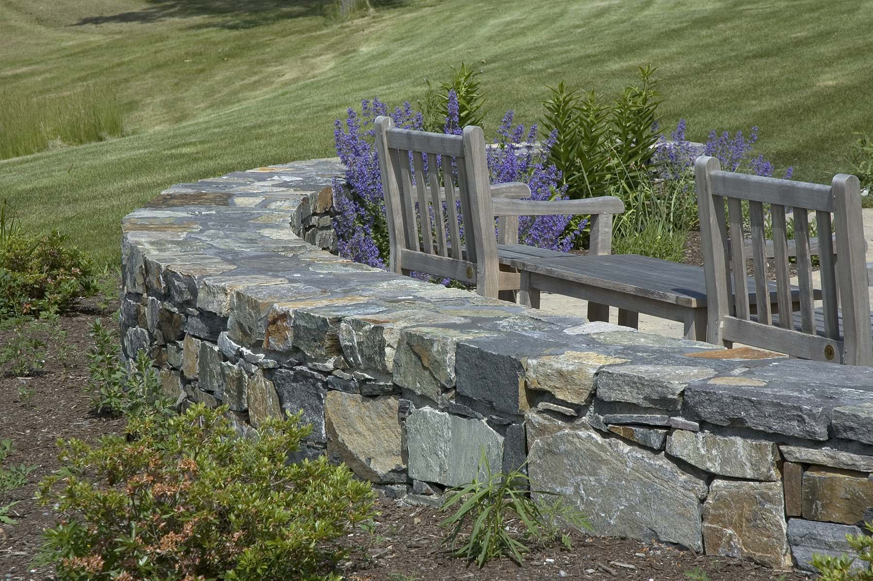 natural Adirondack stone wall by sitting area