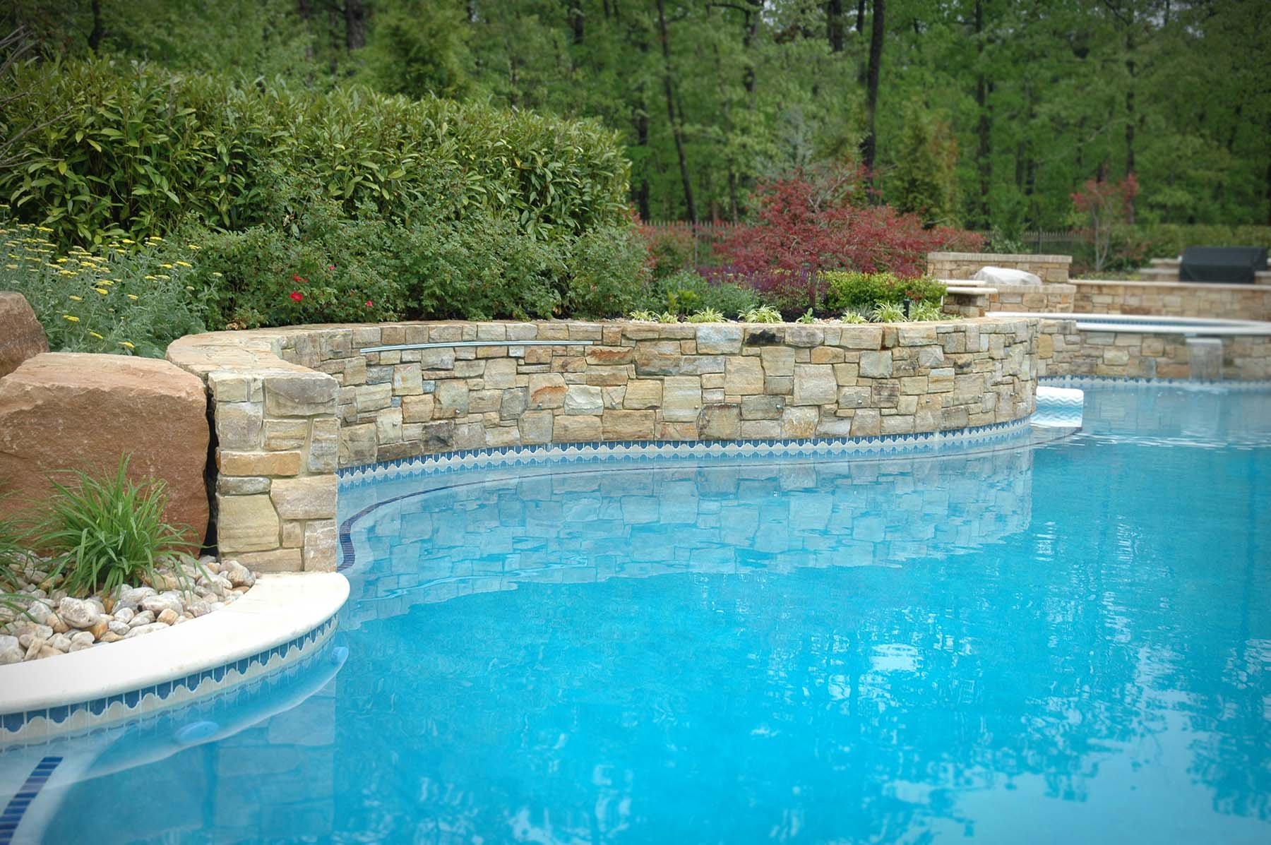 Pool with South Bay Quartzite natural building stone exterior retaining wall