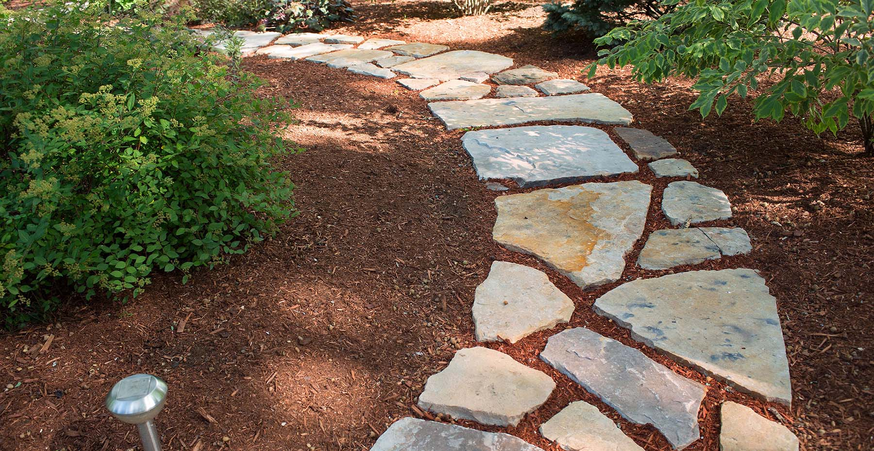 South Bay Quartzite natural stone flagging walkway in garden