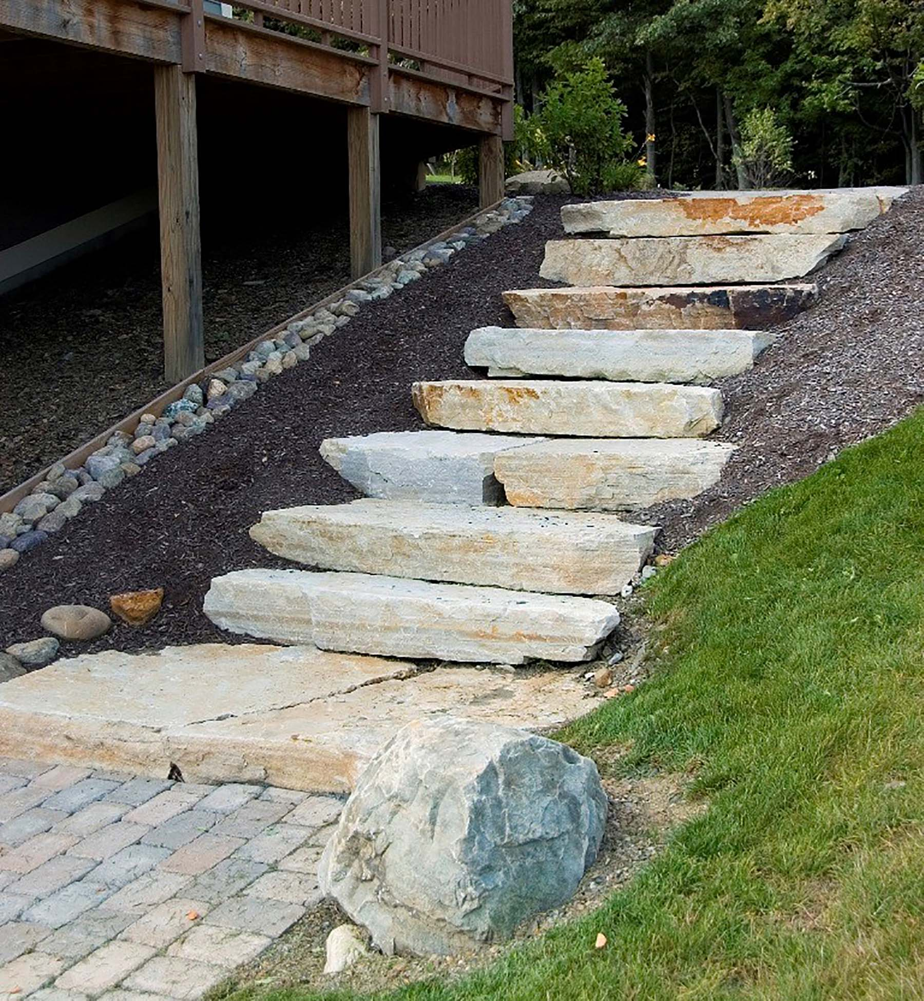 South Bay Quartzite natural stone slab staircase beside residential home