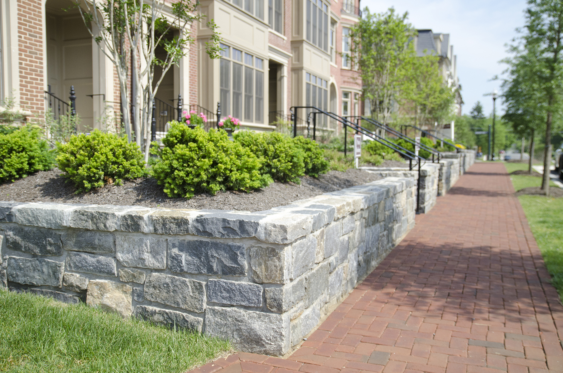 sidewalk and stone flower beds