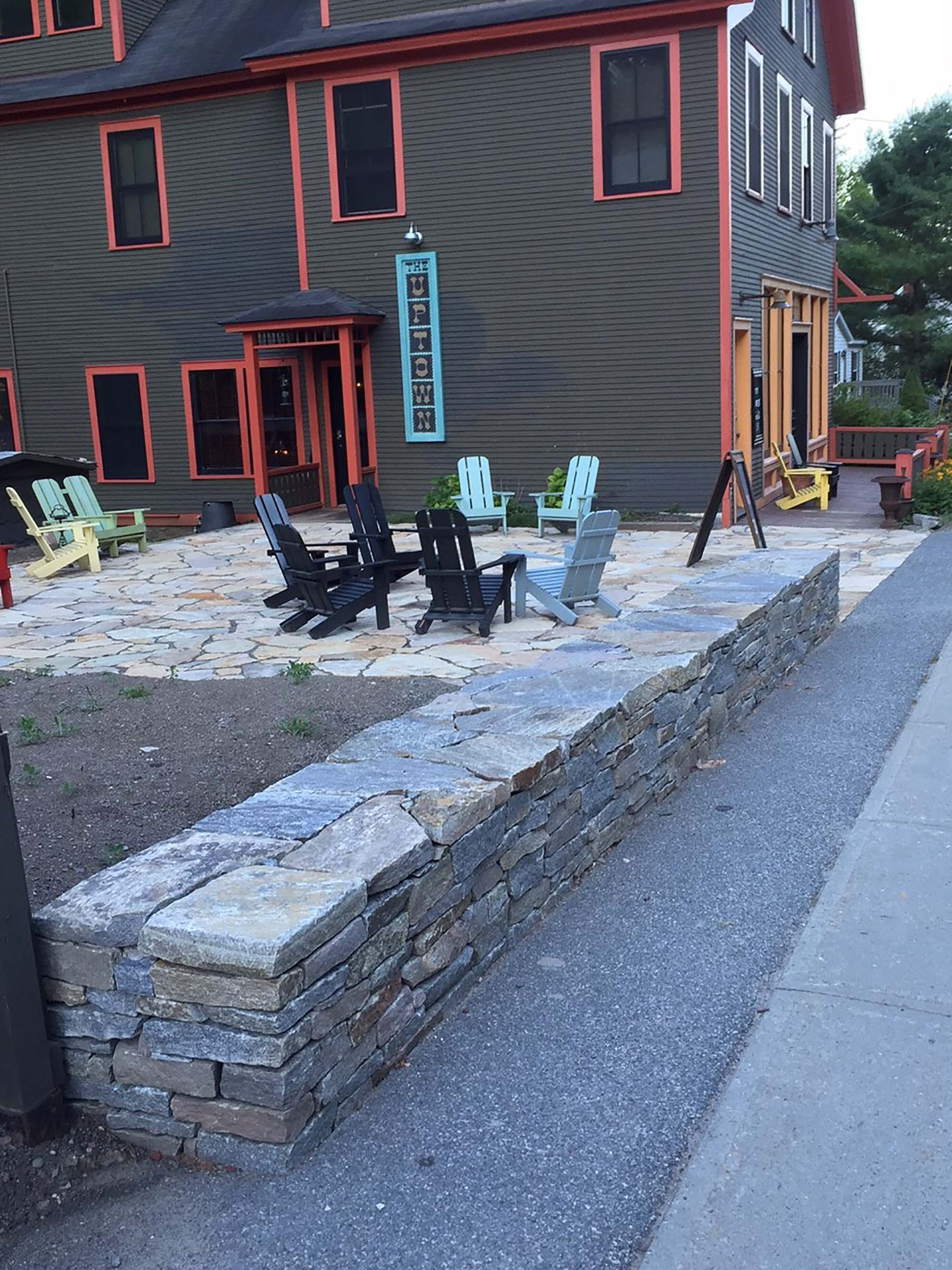 natural stone Ticonderoga granite wall and patio outside business
