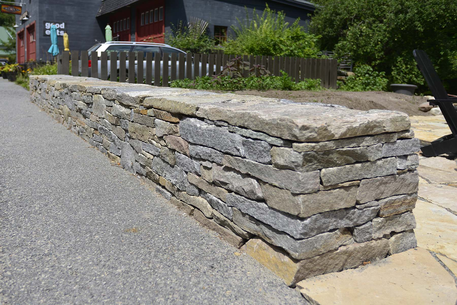 natural stone Ticonderoga granite wall outside business