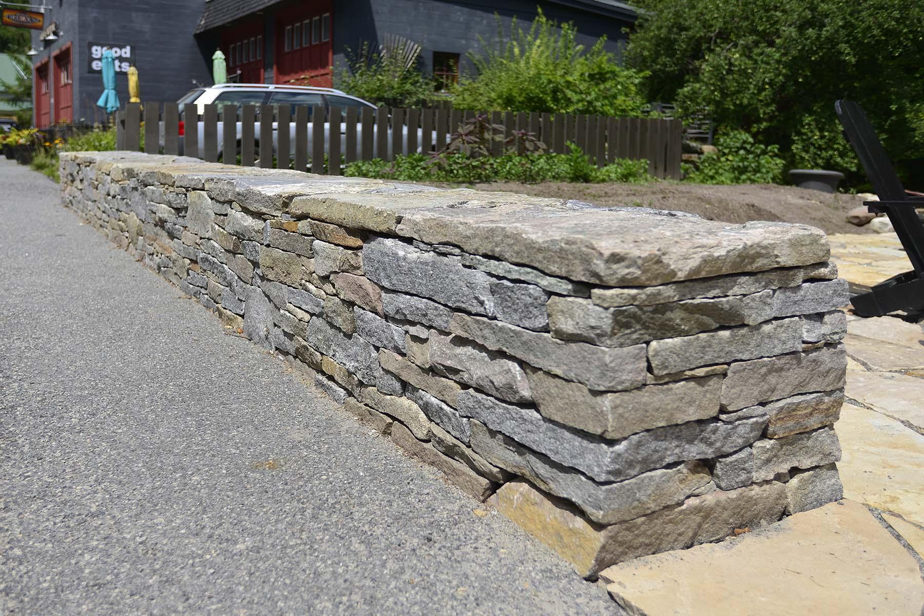natural stone Ticonderoga granite wall outside business