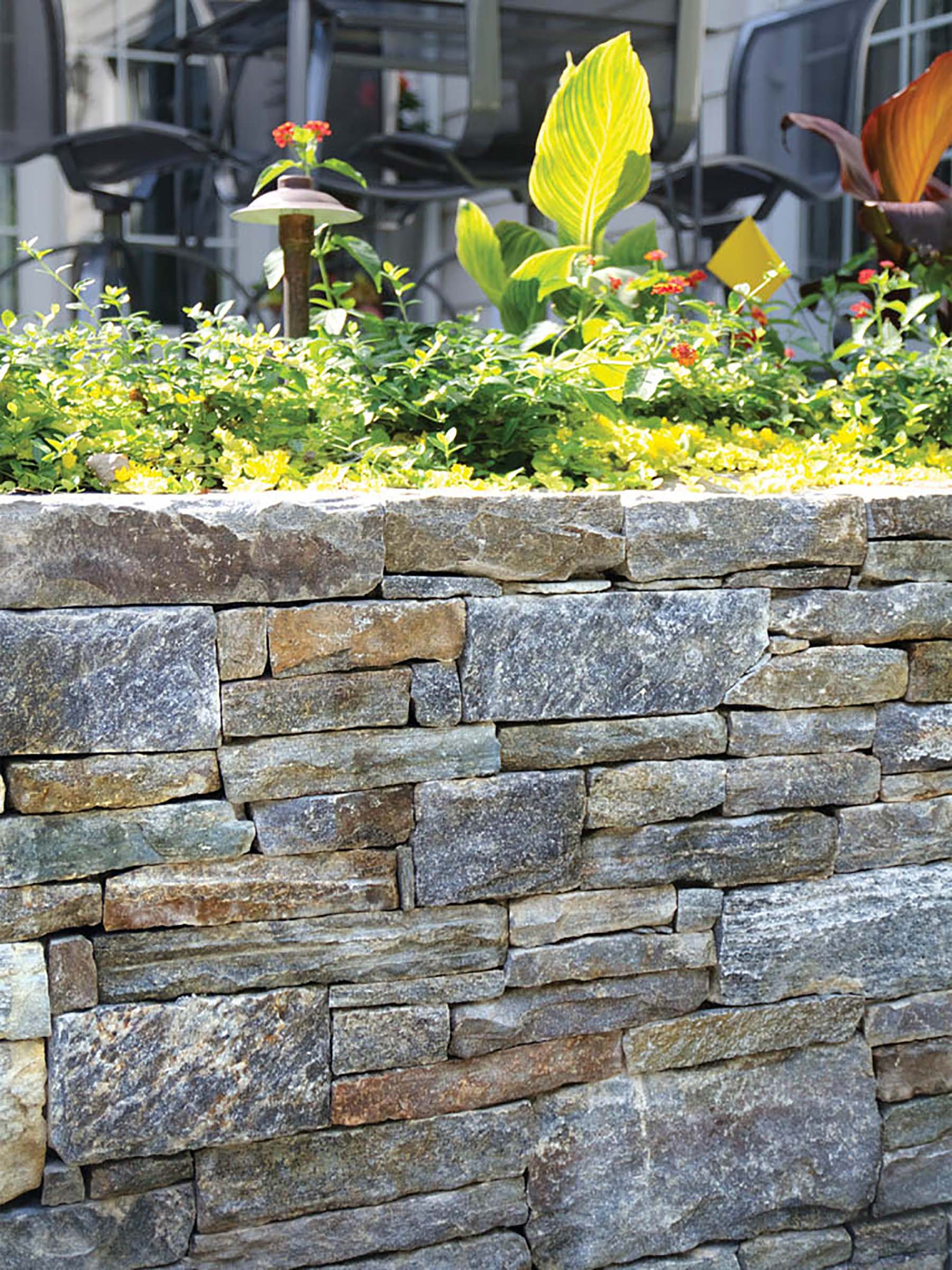 Ticonderoga Granite cottage wall in garden