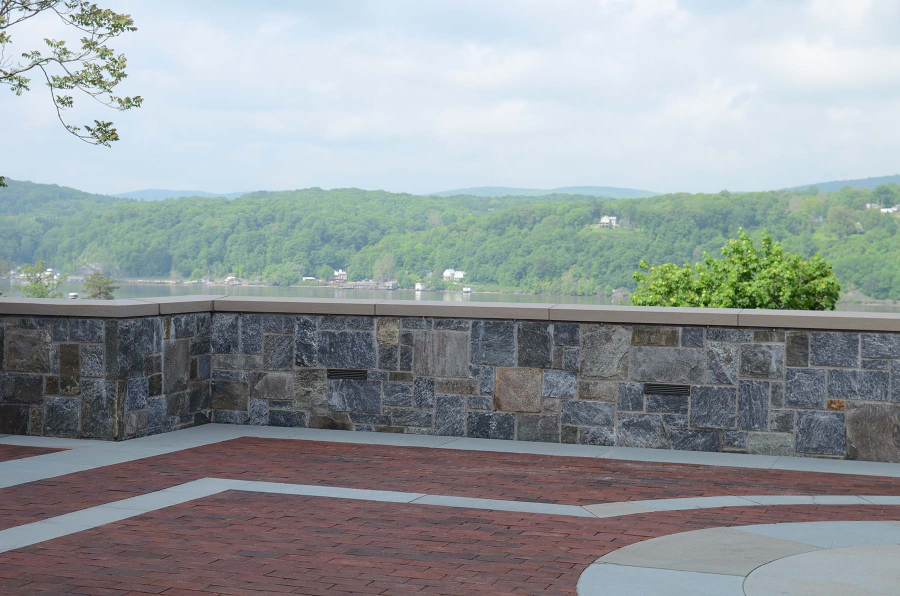 Ticonderoga granite natural stone wall in park overlooking lake