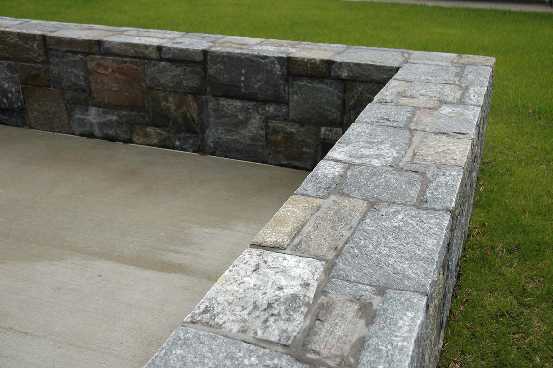 Ticonderoga granite natural stone wall in park