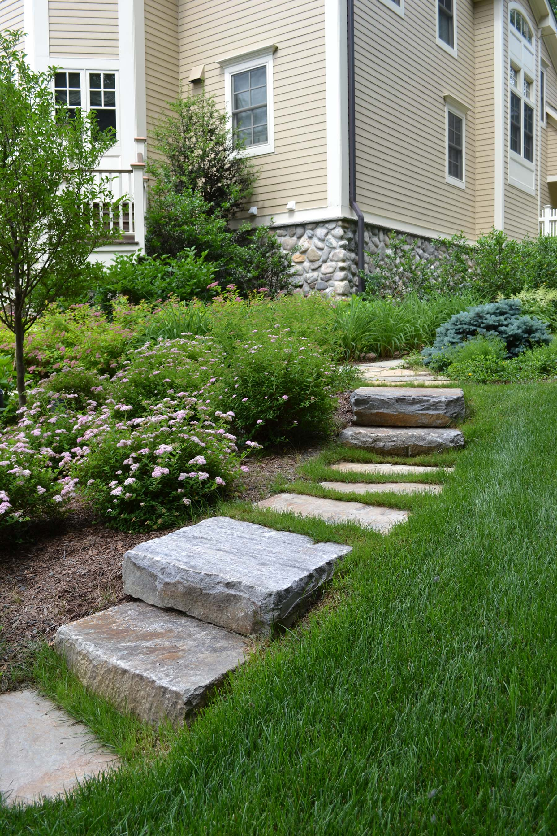 natural stone Ticonderoga granite steps in residential backyard