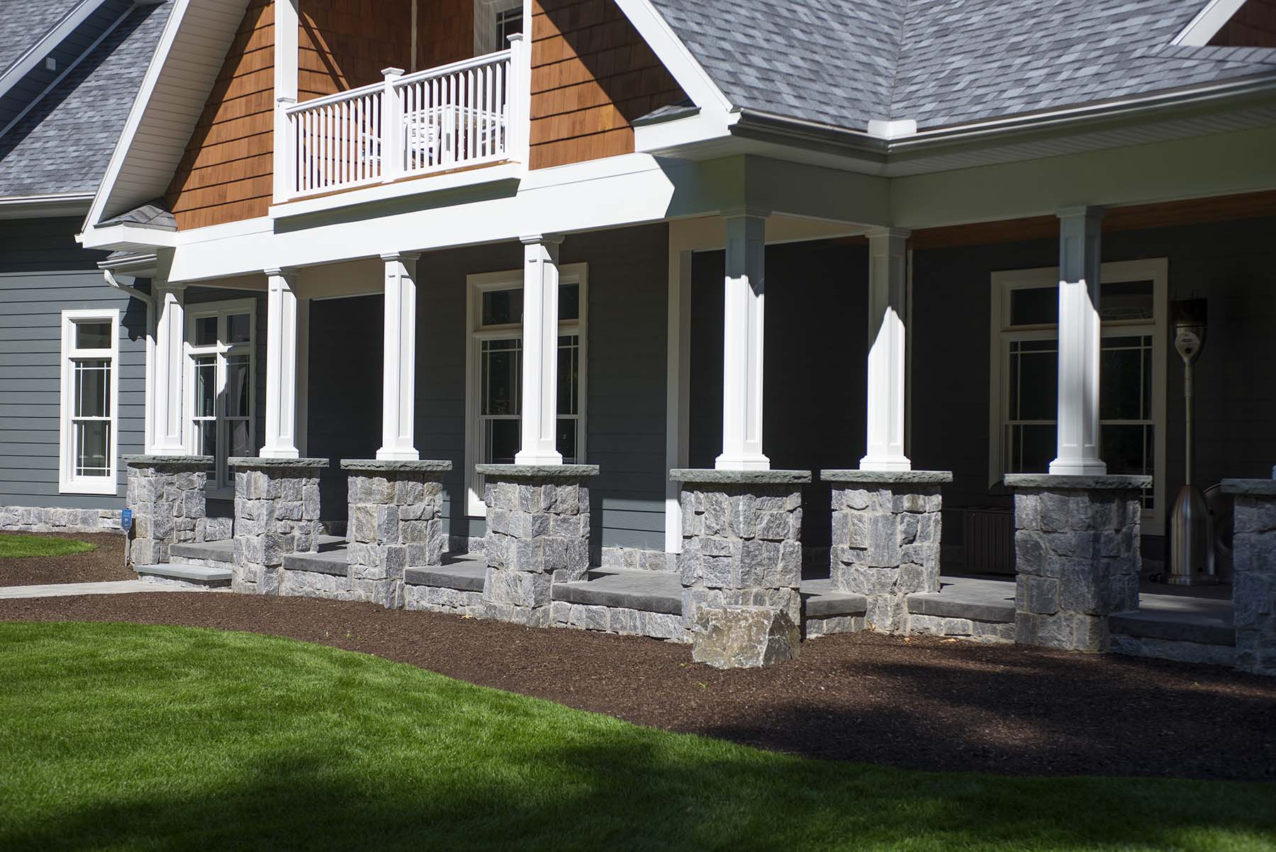 natural stone porch constructed from wood creek granite