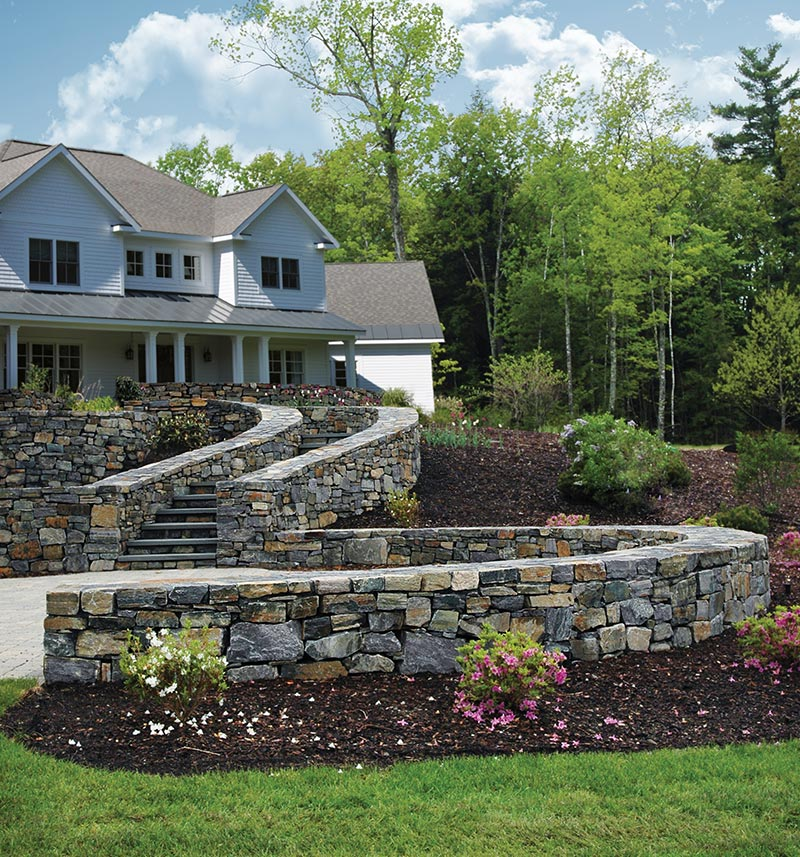 natural Adirondack stone wall and stairs in front of house