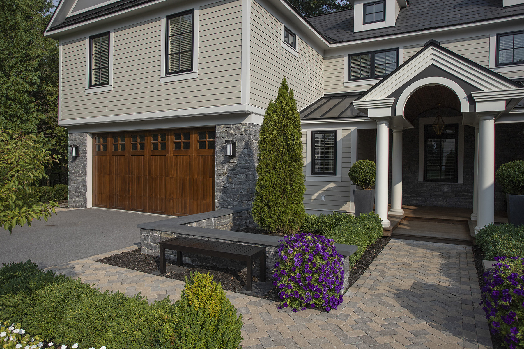 stone garage with wooden doors