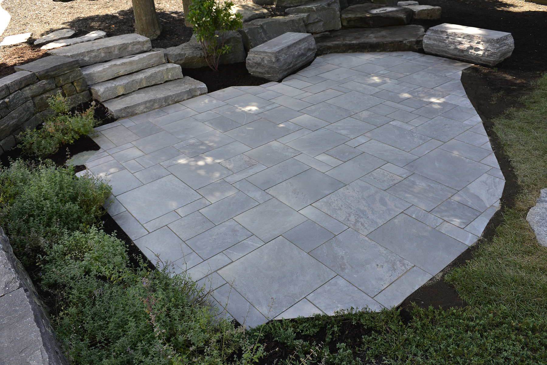 Dimensional stone with landscaping stone
