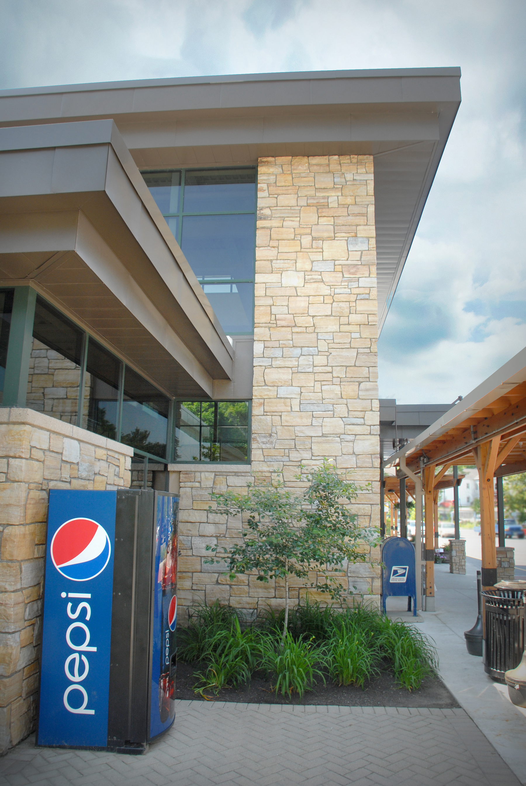 pepsi machine in front of stone building