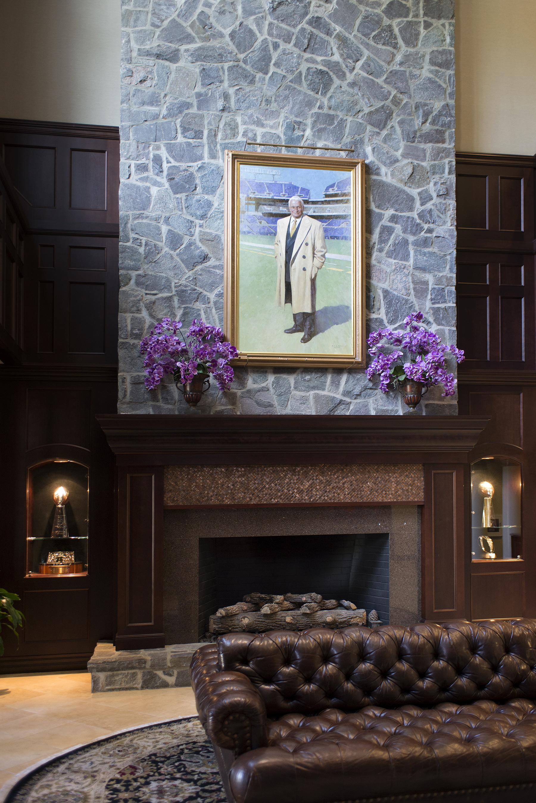 fireplace with large portrait hanging above