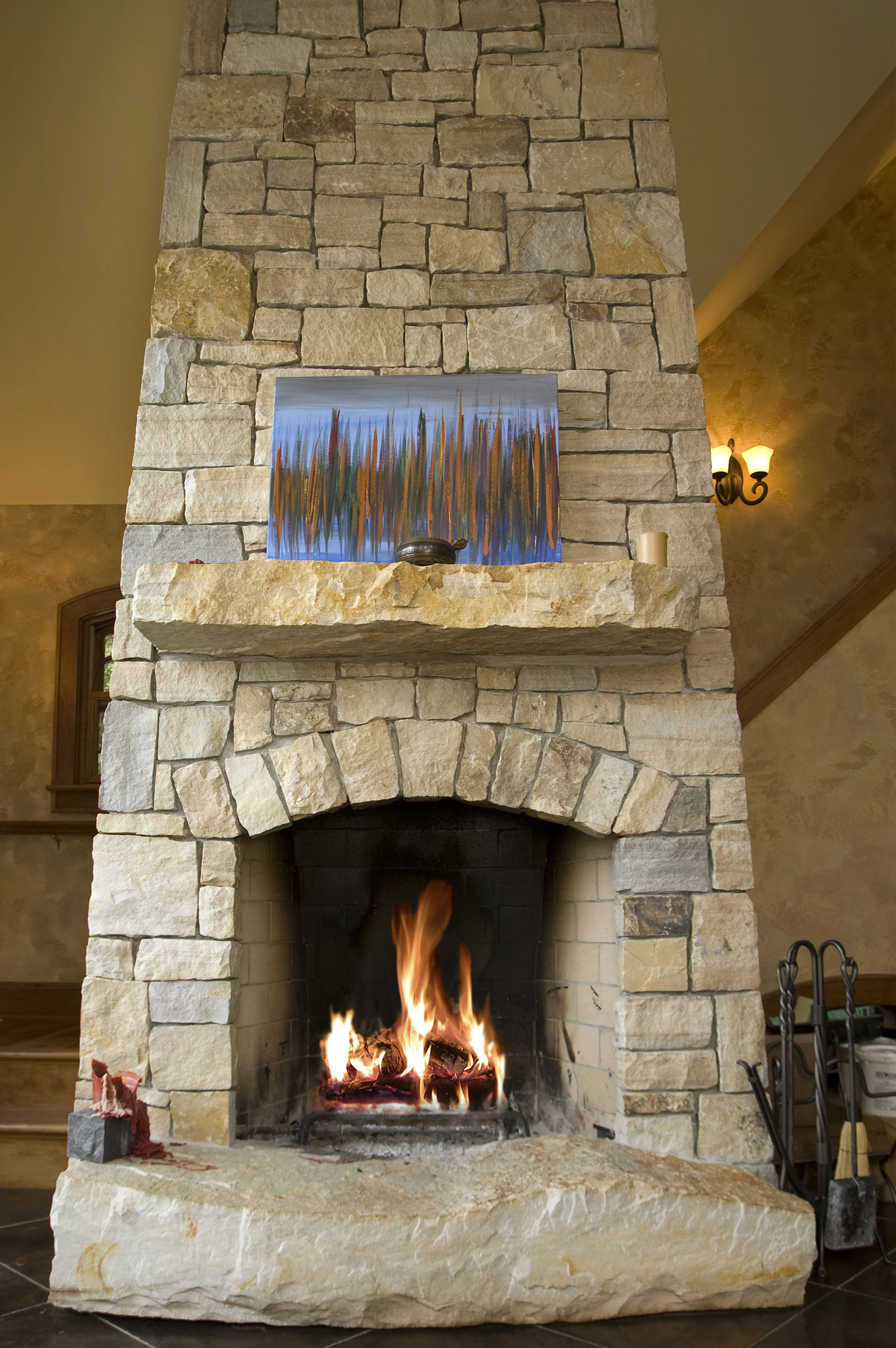 view of stone fireplace and chimney