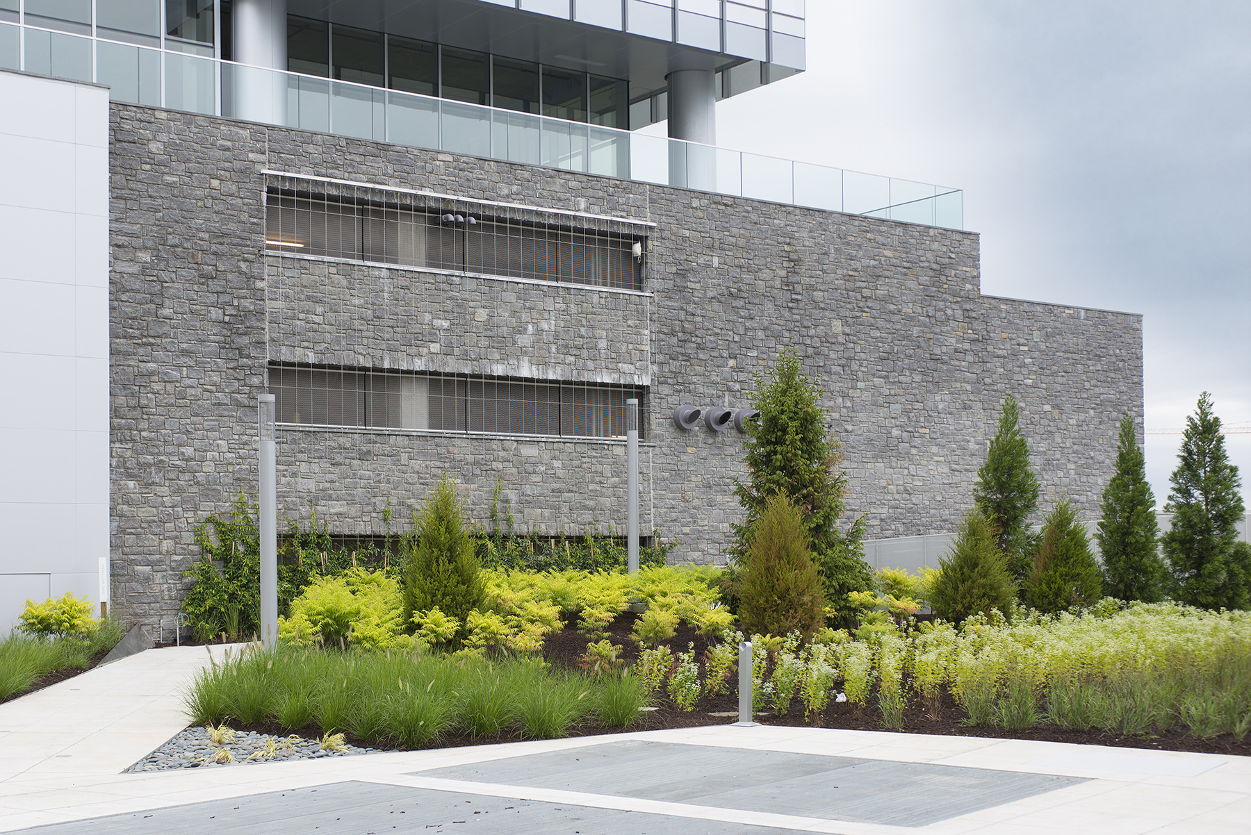 gray stone building with flower beds